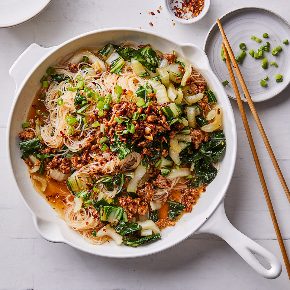 "These spicy noodles are inspired by a Chinese dish called Ants Climbing a Tree, named for the way the small pieces of ground pork (the ""ants"") cling to the noodles (the ""tree""). The twist in these healthy noodles comes from adding vegetables like scallions and bok choy."