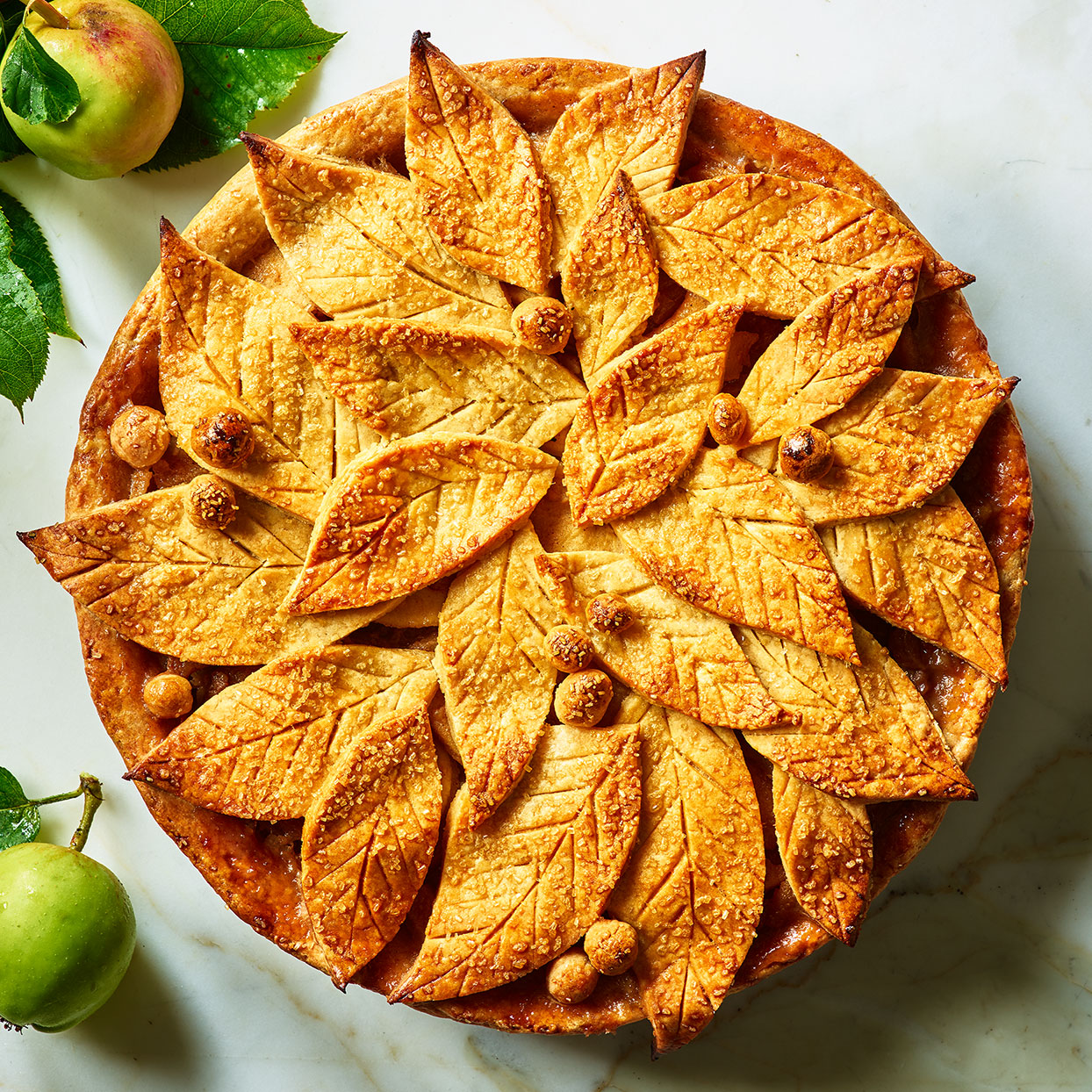 This homemade apple pie recipe has a simple and classic flavor, with fresh apples, spices and butter that's been sizzled until it's brown and nutty. The top crust is where you have the opportunity to add a touch of pizazz. Here we suggest cutting the dough into leaf shapes for an autumnal motif, but you could cut any shape you want. Source: EatingWell Magazine, November 2019