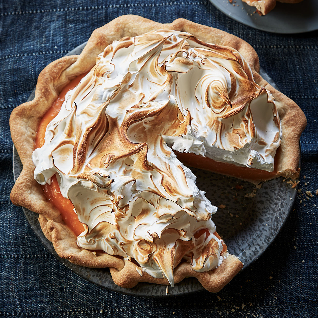 For this pie's filling we call for fresh squeezed grapefruit juice, but store-bought (not frozen) works well and may even give you more brightly colored results. The Italian meringue topping is made by beating hot sugar syrup into egg whites that are already beaten to stiff peaks. It's a bit more effort, but the meringue holds its shape longer. Source: EatingWell Magazine, November 2019