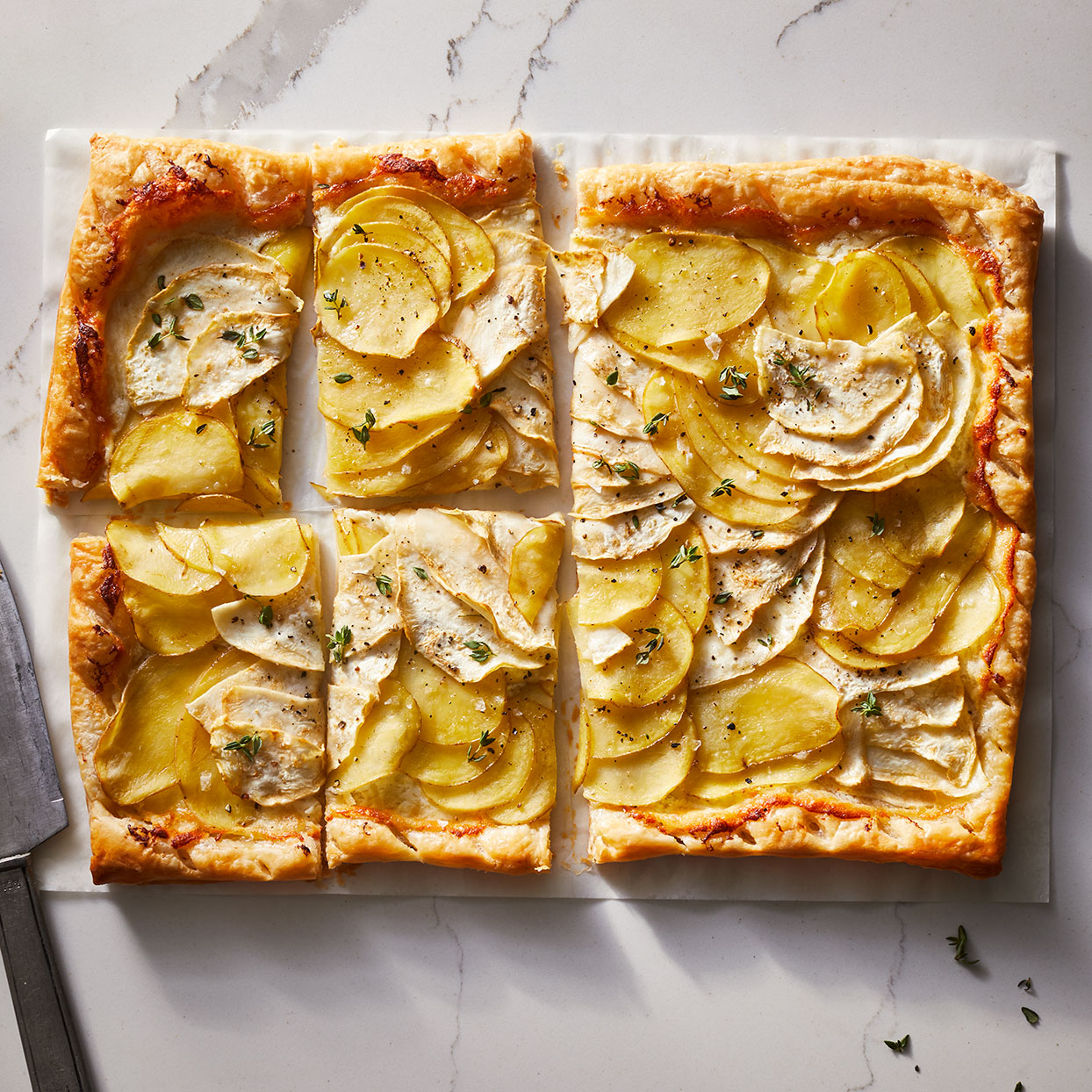 This tart is as beautiful to look at as it is to eat. Serve this potato tart as an appetizer or cut a larger serving for a healthy vegetarian dinner. If you don't have a mandoline, use your sharpest knife to slice the potatoes and celeriac as thin as possible.