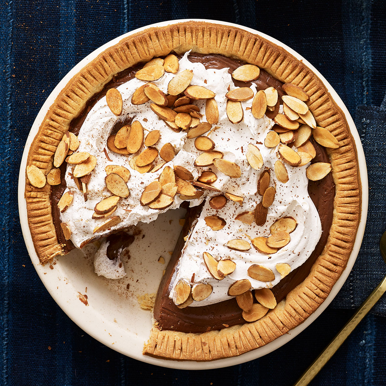 Who knew a pie recipe could taste so good? Homemade chocolate pie is a must-have at many holiday gatherings and this one will set a new bar. The velvety filling is lightened up by swapping in some cornstarch for some of the egg yolks traditionally used for thickening. The pairing of bittersweet chocolate with the nutty amaretto flavor is pure almond joy that's only better topped with cinnamon-spiced whipped cream (included!).