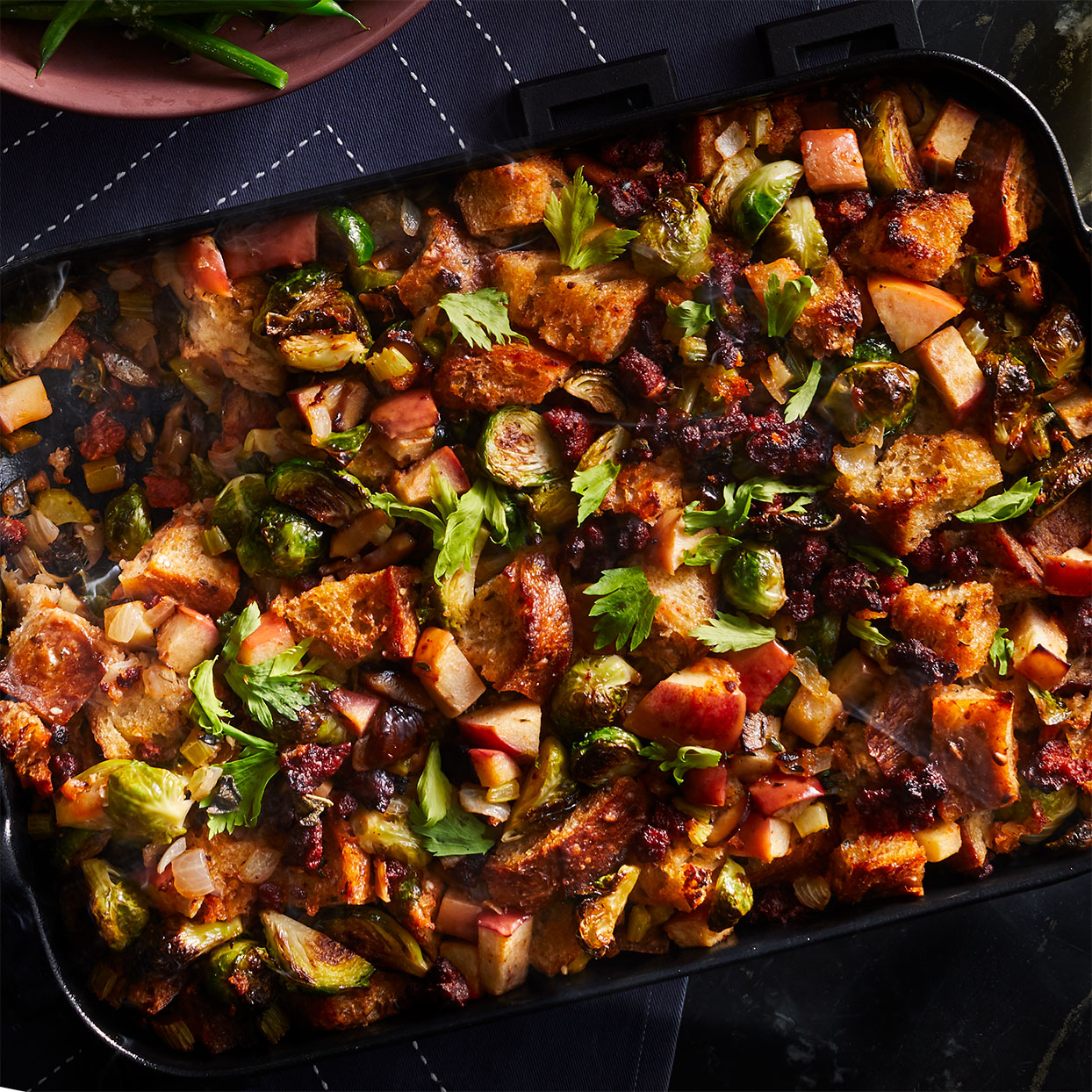 Who says a Thanksgiving stuffing recipe has to be dominated by the bread? Check out this veggie-packed healthy stuffing, with 4 cups of Brussels sprouts topping the list. Chorizo adds some piquant flavor, in this case a zesty chile-pepper-and-vinegar kick found in the Mexican version of the sausage, but quite frankly you won't go wrong using any type of fresh, spicy sausage.