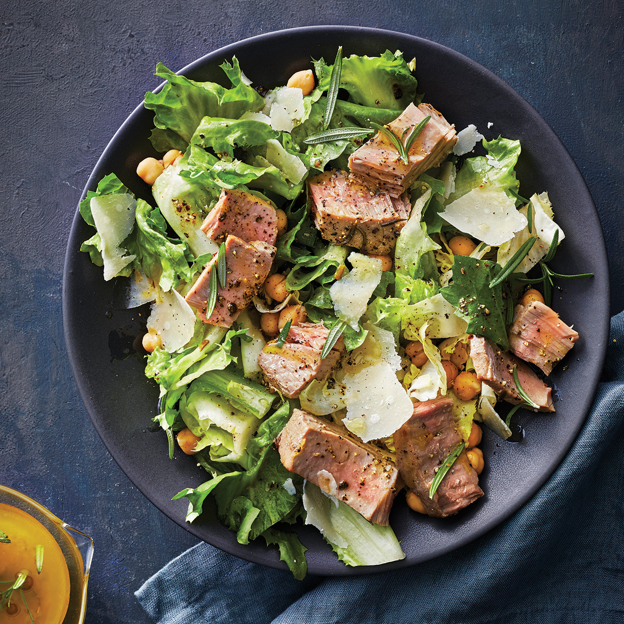 This fish salad is a unique twist on traditional slow-cooker fare. The slow-cooker tuna steaks carry the bright lemon and rosemary flavors well, which result in an aromatic and fresh fish that perfectly complements the lettuce and chickpeas. Chill it for an easy work lunch the next day. Garnish with fresh rosemary leaves, if desired. Source: Everyday Slow Cooker