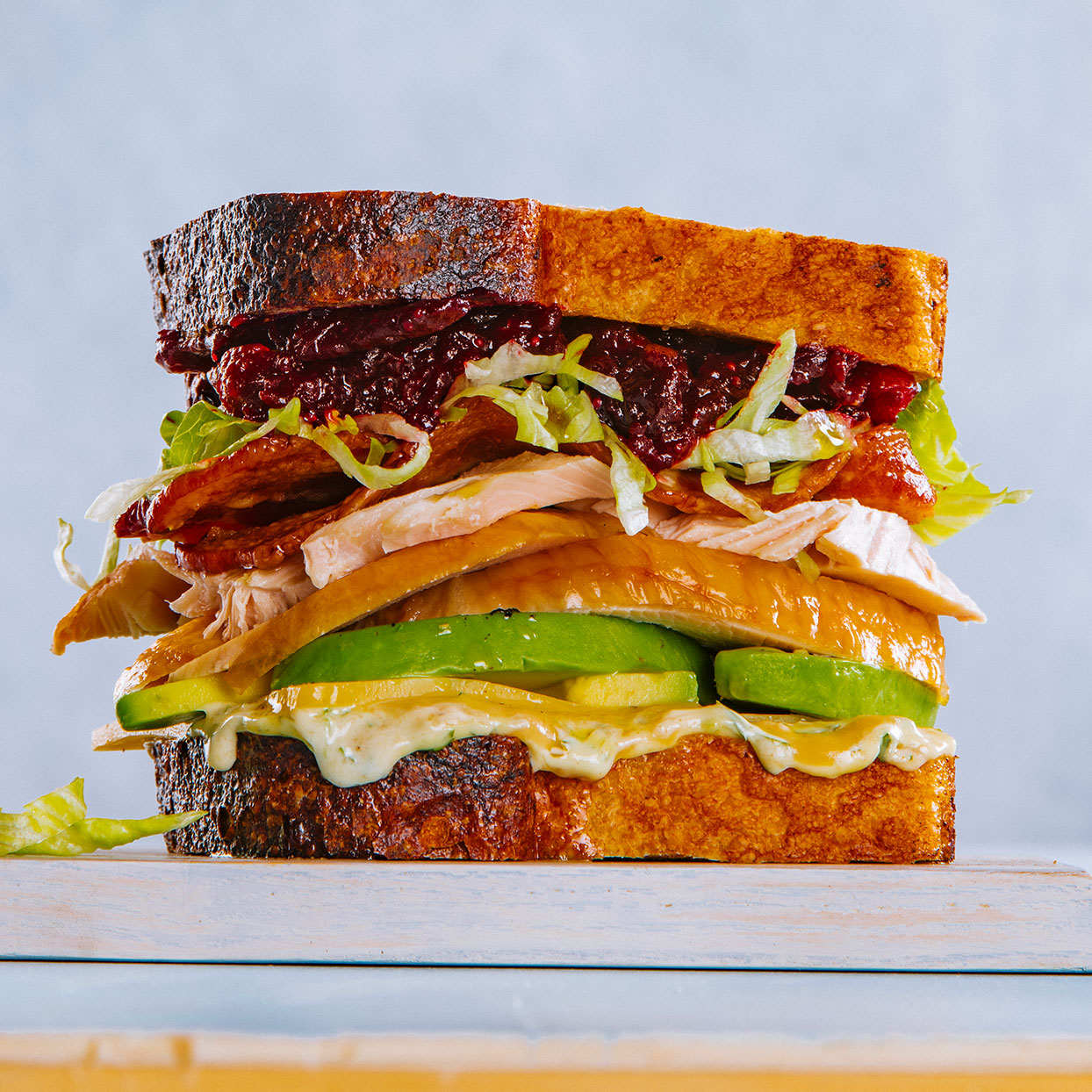 After Thanksgiving, we cannot get enough leftover turkey recipes—and this healthy turkey avocado sandwich will help you use up Thanksgiving leftovers and more. If you really want to do this sandwich up, chef Hugh Acheson suggests searing a slice of turkey stuffing or bread pudding until it's nice and crispy and putting it between the turkey and avocado.