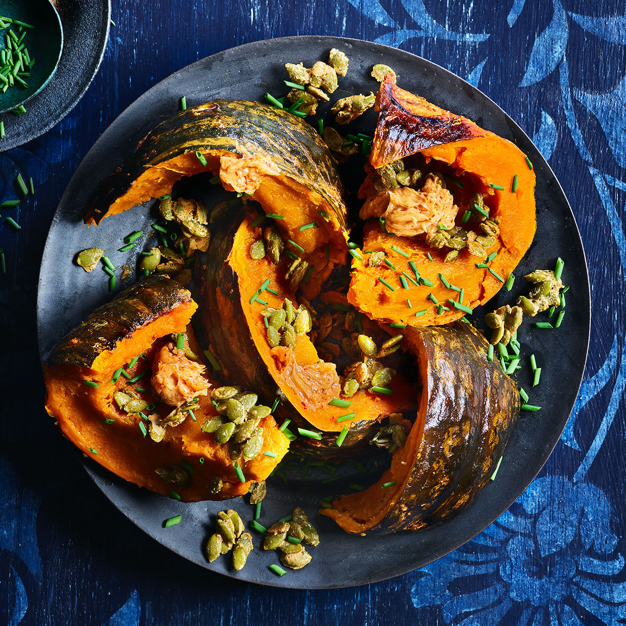 Ever wondered how to cook kabocha squash without ruining your knife? Roasting it whole softens its armor and creates nutty, complex flavor inside. Topped with a savory butter sauce and sweet pumpkin seeds, this Thanksgiving vegetable recipe creates a superstar. Source: EatingWell Magazine, November 2019