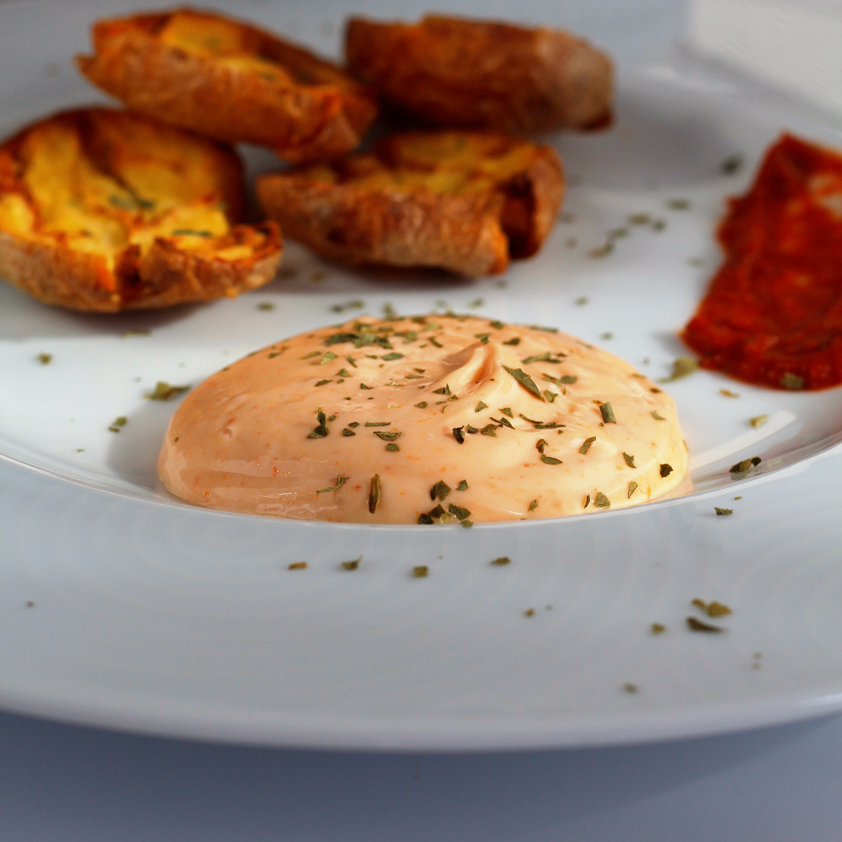 "This simple condiment combines a traditional Mediterranean aioli with harissa paste. ""This recipe comes from the Northern region of Italy where they use a cooked egg and lemon-soaked egg yolks,"" says Buckwheat Queen. ""This is delicious on just about anything. I like it with a frittata or oven-fried potatoes. It will last up to 4 or 5 days in the refrigerator."""