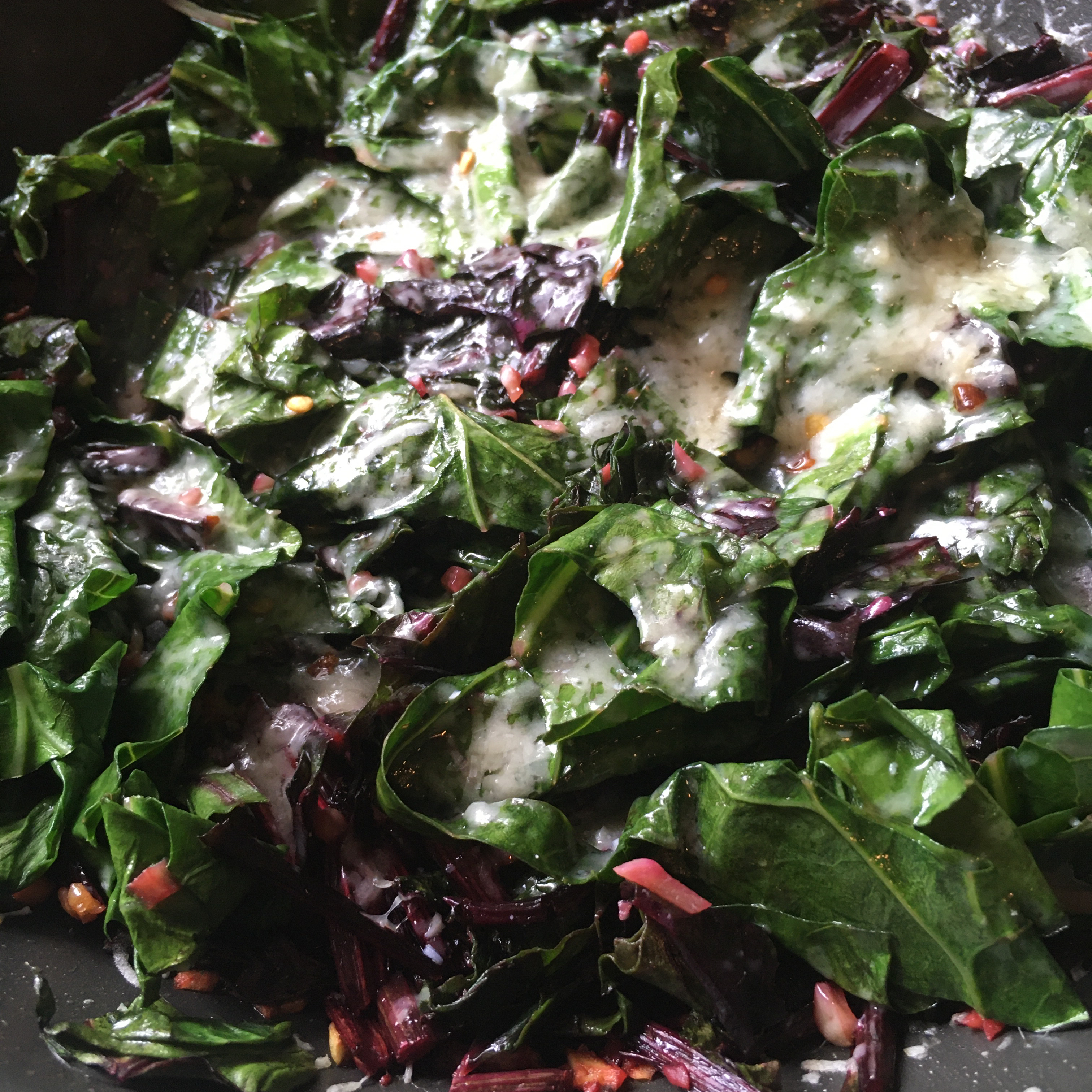 """Kale, chard, or collards are great sauteed with garlic and topped with melted Parmesan cheese. """"I used beet greens and collard greens,"""" says barbara. """"Came out really well. I sautéed the beat greens first with the garlic, and then put in all the greens. Great recipe to use up all sorts of greens."""""""