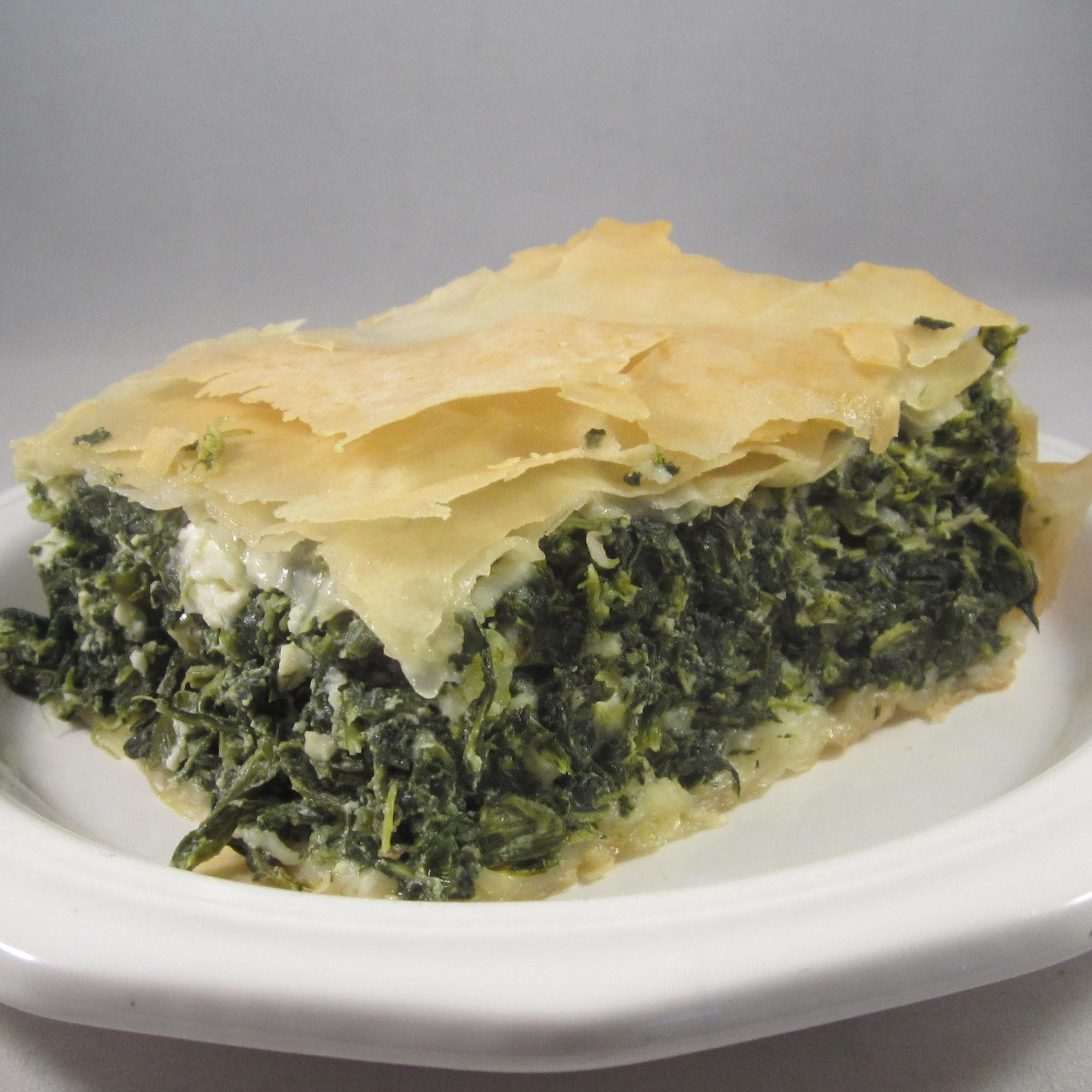 "This Greek spinach pie with a rich cheese and spinach filling and a phyllo crust bakes up beautifully golden brown. ""Old World recipe and tradition,"" says Sandy Parks. ""Looks complicated, but not -- and best tasting one I've had."""