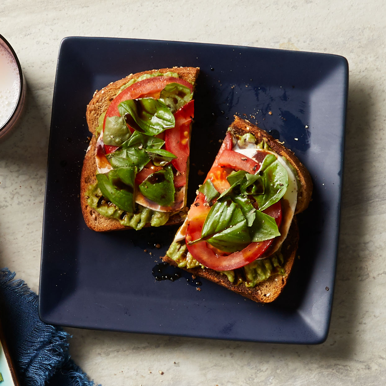 Tomatoes, mozzarella, and basil--the building blocks of caprese salad--lend a creative twist to a standard avocado toast recipe. Source: Diabetic Living Magazine, Winter 2020