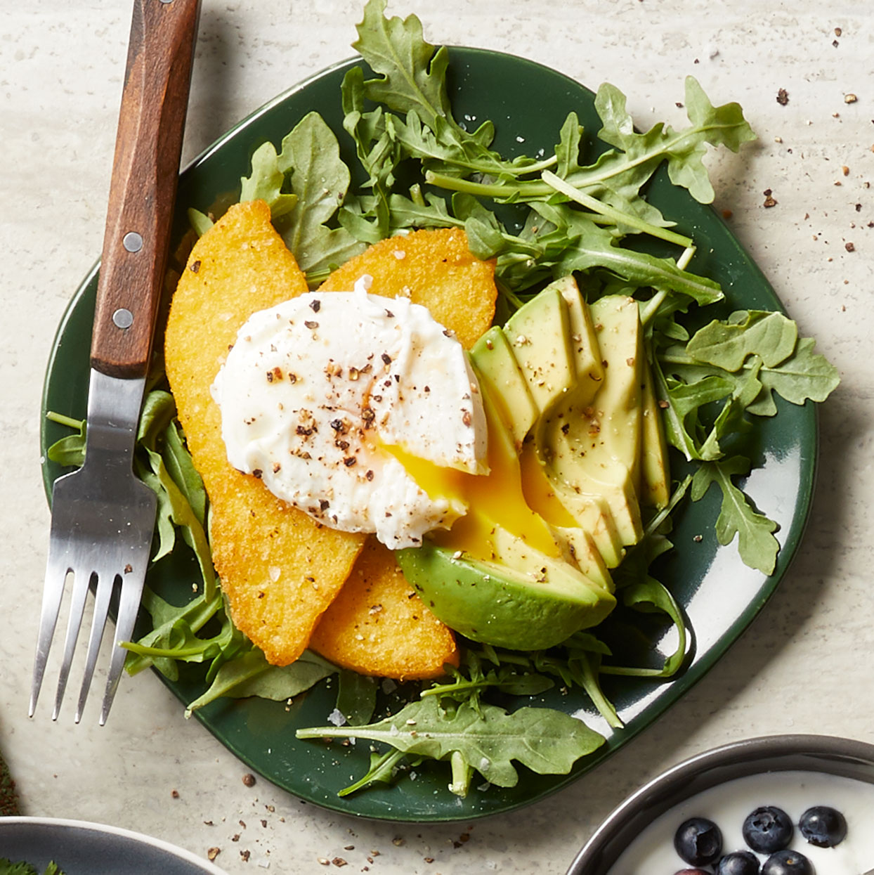 Precooked polenta makes this savory healthy breakfast a breeze. Serving the easy poached eggs on a bed of arugula is a wonderful way to get a head start on your daily vegetable intake.