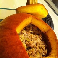 """The mellow flavor of pumpkin makes it an excellent canvas for rich ground venison, spicy dry mustard and black pepper, fragrant sage, and smoky bacon grease. """"This is a beautiful dish to serve as a centerpiece to your holiday celebration,"""" says recipe creator ONEMINA, and we're inclined to agree."""
