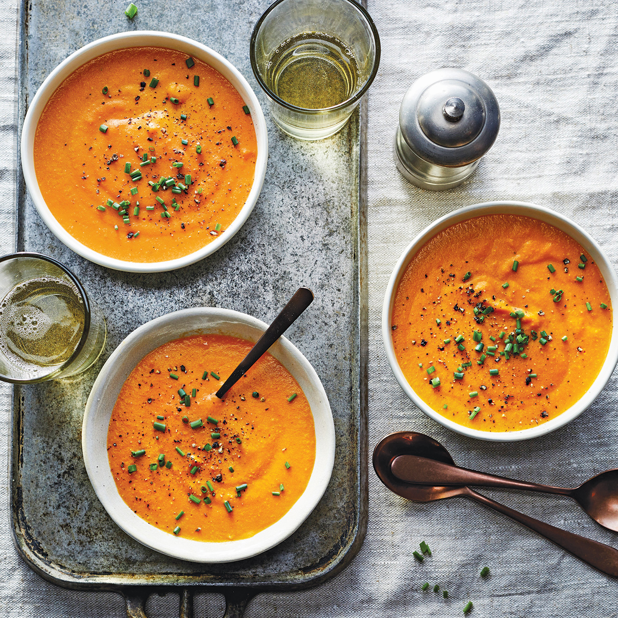 Creamy and delicate slow-cooker carrot soup is a welcome appetizer. The addition of millet--a whole grain similar to quinoa--adds body to the soup as well as protein and fiber. Garnish with additional black pepper, if desired.