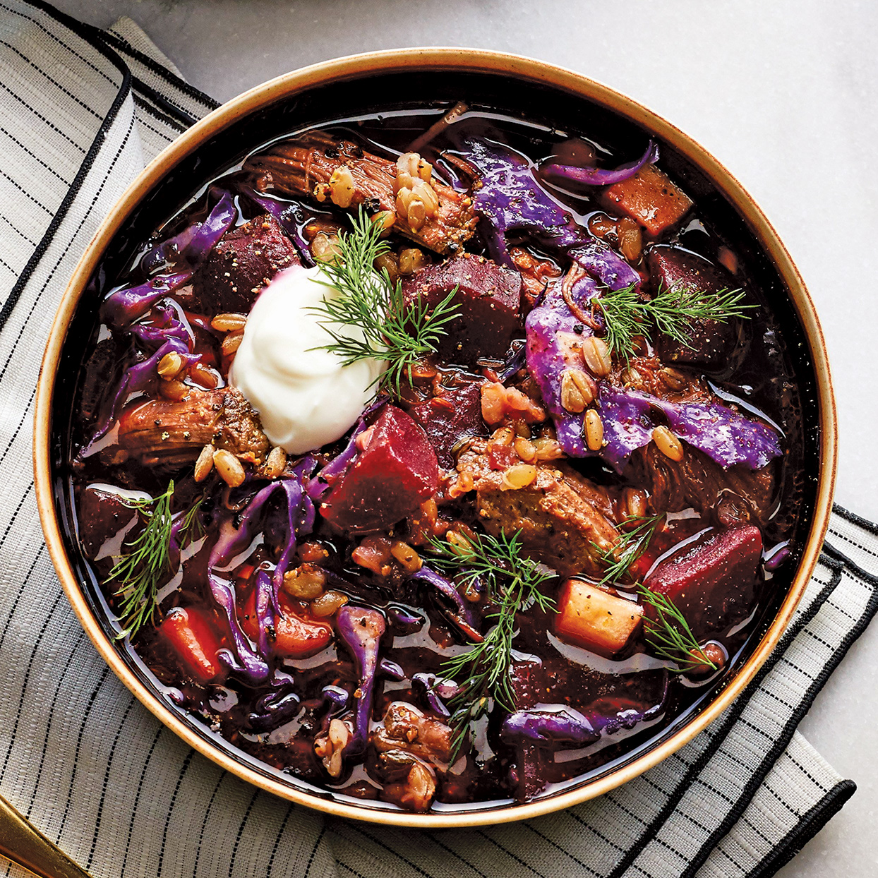Borscht is an Eastern European soup that typically features beets as a prominent ingredient, thus the resulting dish has a purple-red color. Our slow-cooker rendition is literally beefed up with brisket and showcases whole-grain rye berries, a source of fiber.