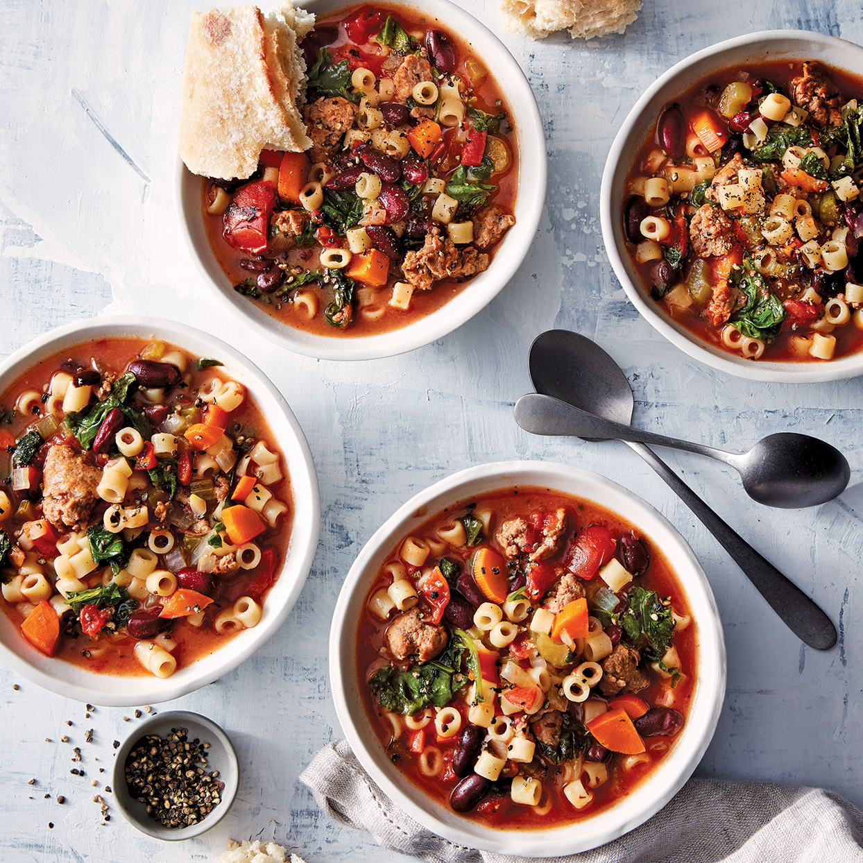 Adjust the heat level in the dish by choosing either hot or mild Italian sausage. You can add red pepper, too, to make it extra hot. Serve this slow-cooker minestrone with crusty bread, if desired.