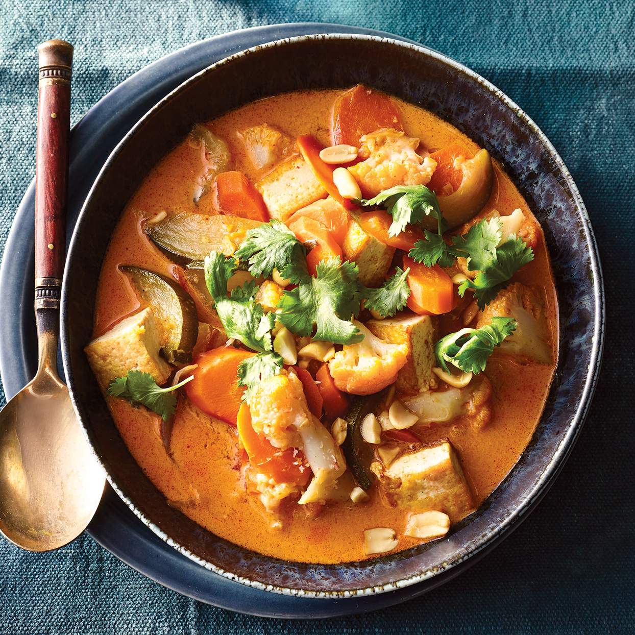 Cauliflower and tofu are ideal ingredients for this soup. The cauliflower soaks up the cooking liquid, and the tofu keeps the dish light, allowing the bold flavors in the liquid—predominantly the curry paste and lemongrass—to take center stage in this slow-cooker tofu stew.
