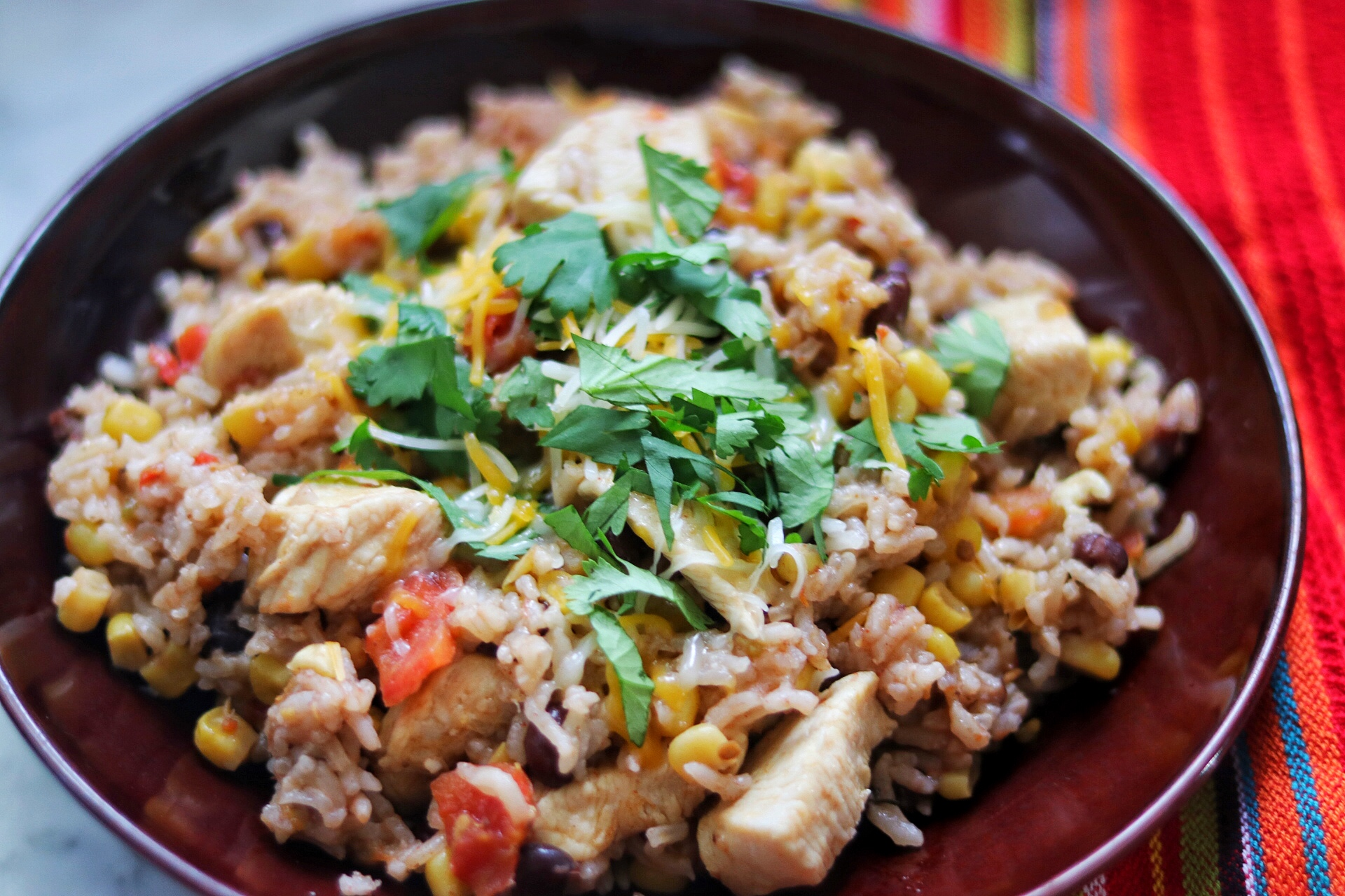 """""""This easy, one-pot, Mexican chicken and rice dinner is done in about 30 minutes,"""" says fabeveryday. """"Serve with other toppings like avocado and sour cream, if desired."""""""