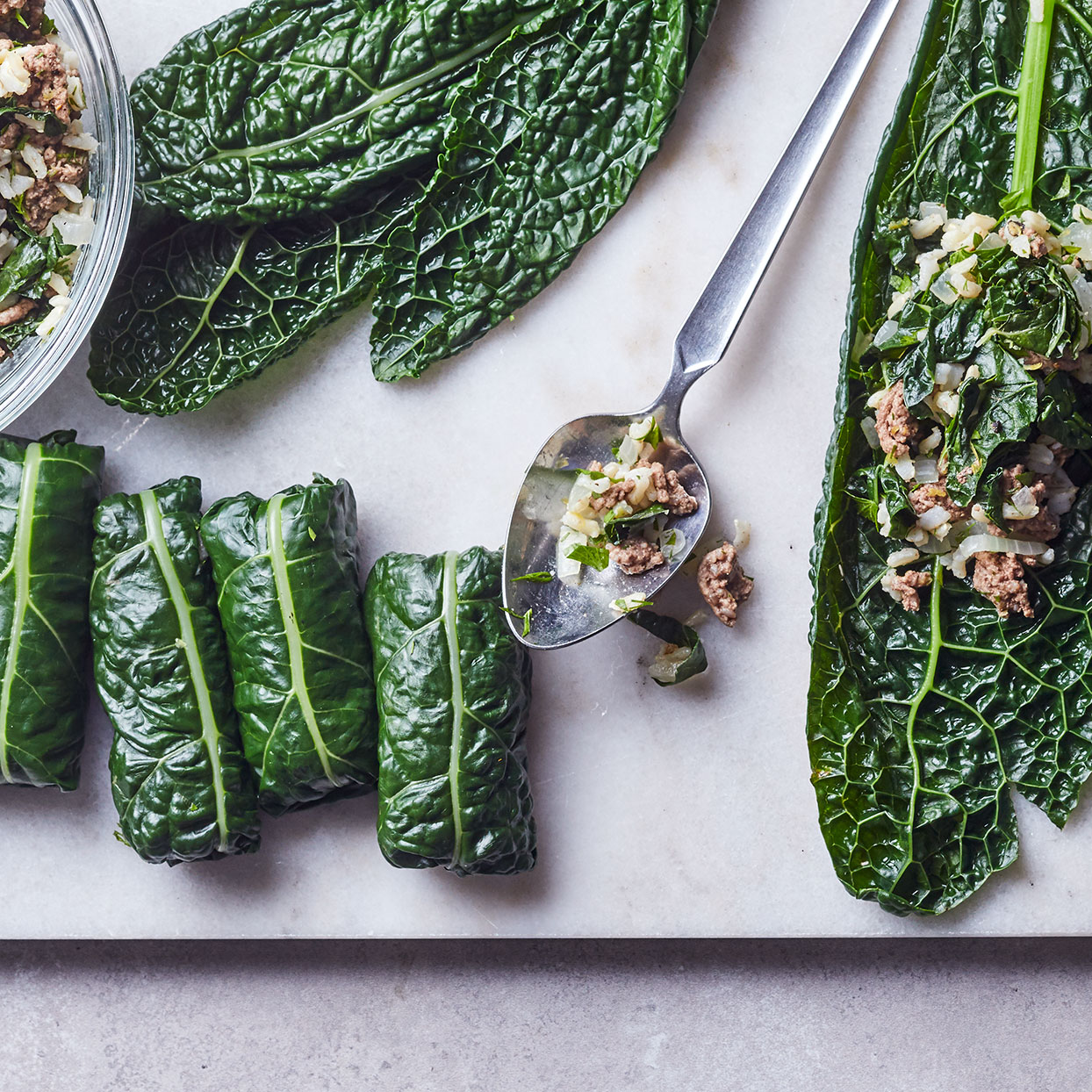 For a quick version of stuffed grape leaves, we've put all the flavors of a traditional dolma recipe into a cooked filling that's simply wrapped in blanched kale leaves--no need to simmer for hours. Source: EatingWell Magazine, December 2019