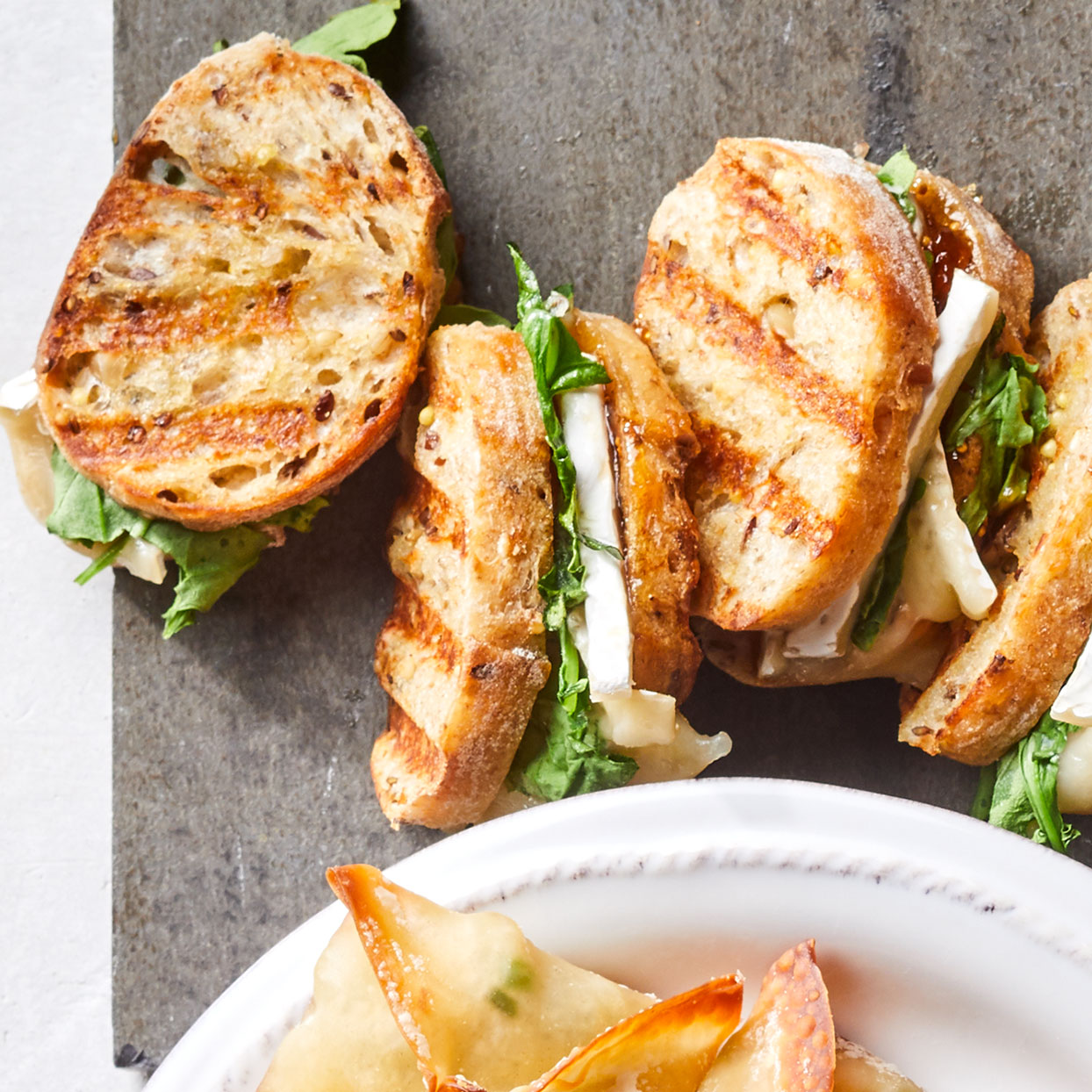 Turn the basics of a cheese board into adorable mini grilled cheese sandwiches for a satisfying appetizer.