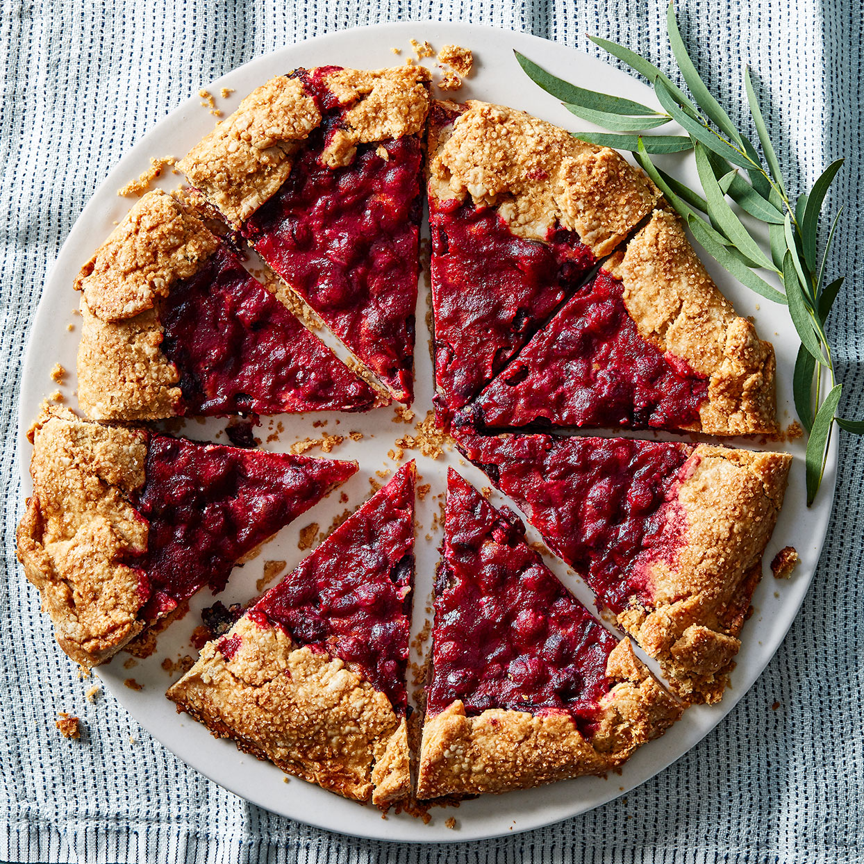 Expand your holiday desserts repertoire with this cranberry galette. Frangipane is a sweet pastry cream typically made with ground almonds; here we substitute ground sesame seeds in the form of tahini to give it a complex, earthy flavor. If you've made the Cranberry-Almond Thumbprint Cookies (see Associated Recipes), you can use some of the leftover jam in Step 9.
