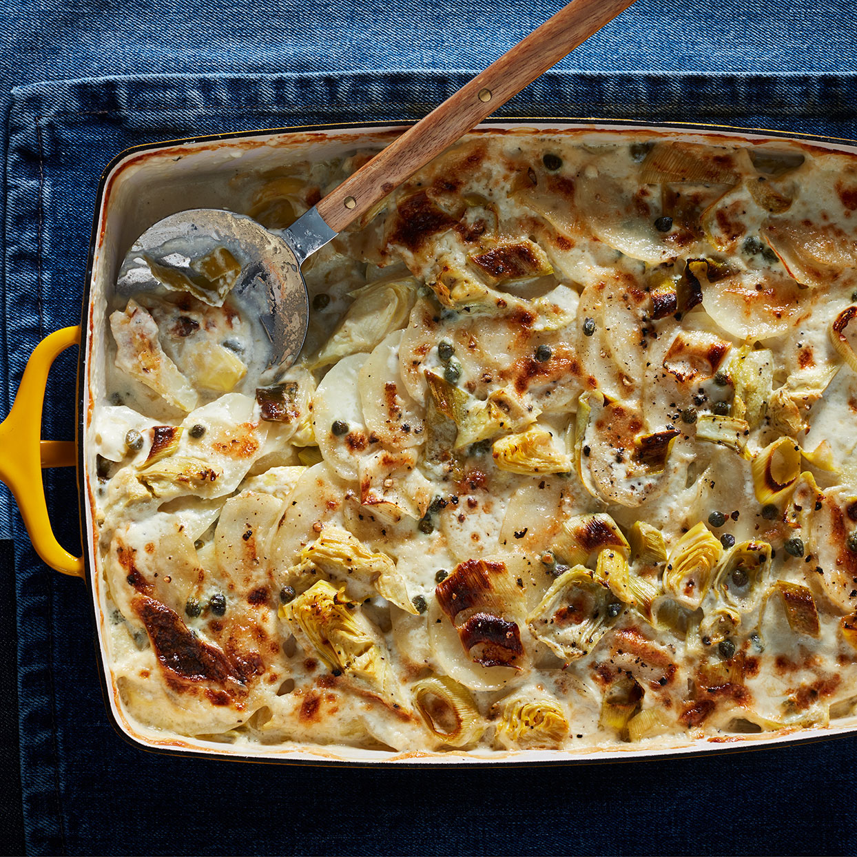 This gratin dish has all of the craveable flavors of artichoke dip in a more sophisticated form. It makes a terrific side with any roasted meats or poultry. Source: EatingWell Magazine, December 2019