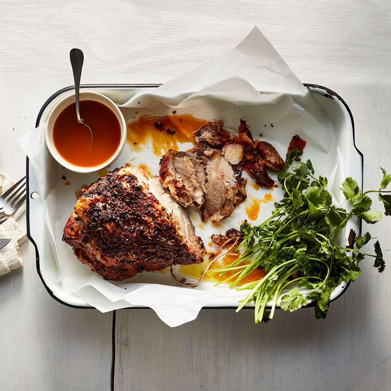 Pork shoulder makes a wonderful roast because it has enough fat to keep it moist and tender during low and slow cooking. The citrus sauce has a smoky, agave sweetness from the tequila and produces a bright counterpoint to the unctuous meat. Serve any extra sauce for dipping. Source: EatingWell Magazine, December 2019