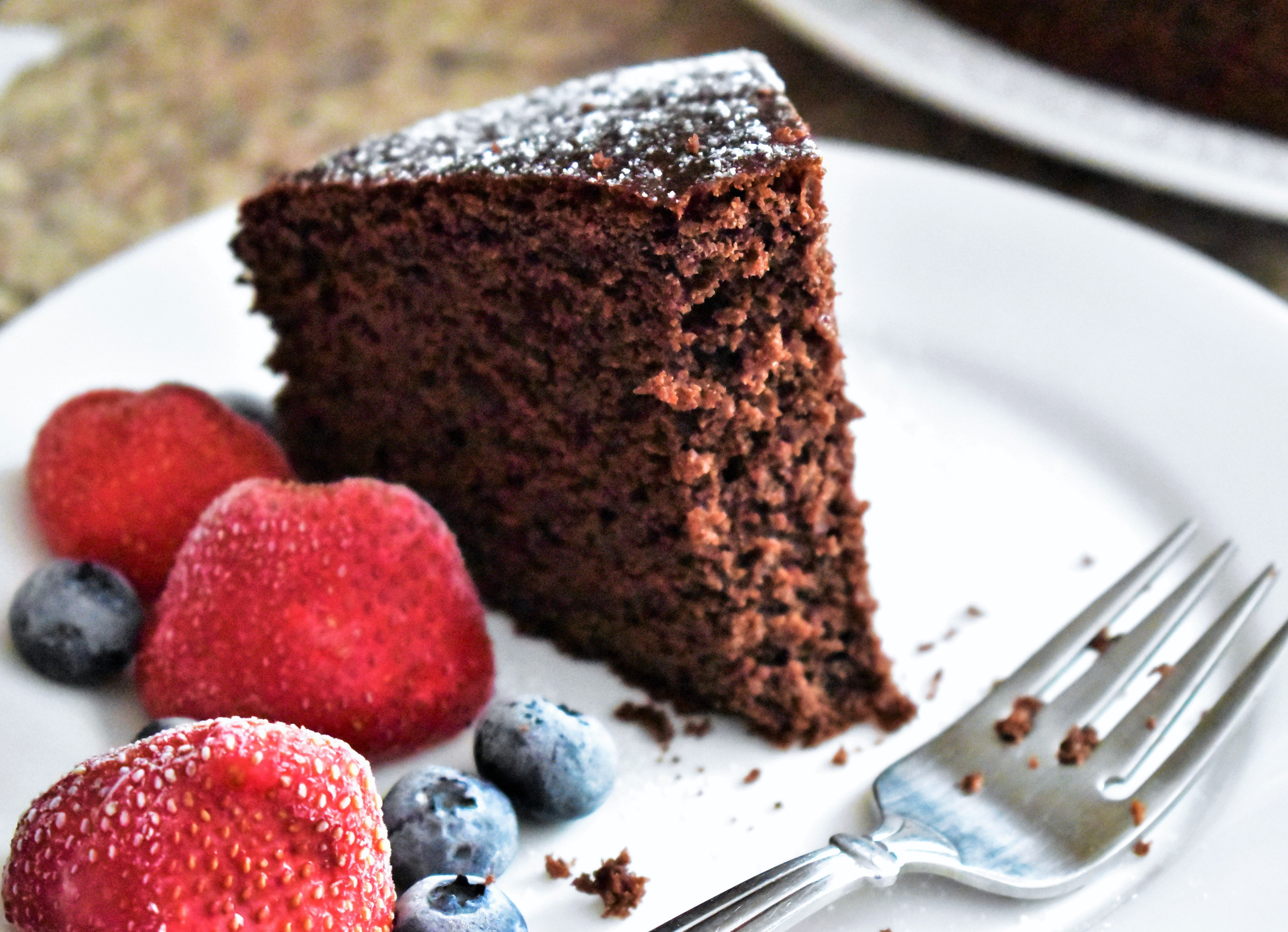 Full-fat yogurt helps keep this whole wheat chocolate mocha cake moist for several days. Serve with a dusting of powdered sugar and fresh berries, or top with chocolate frosting for a more decadent dessert.