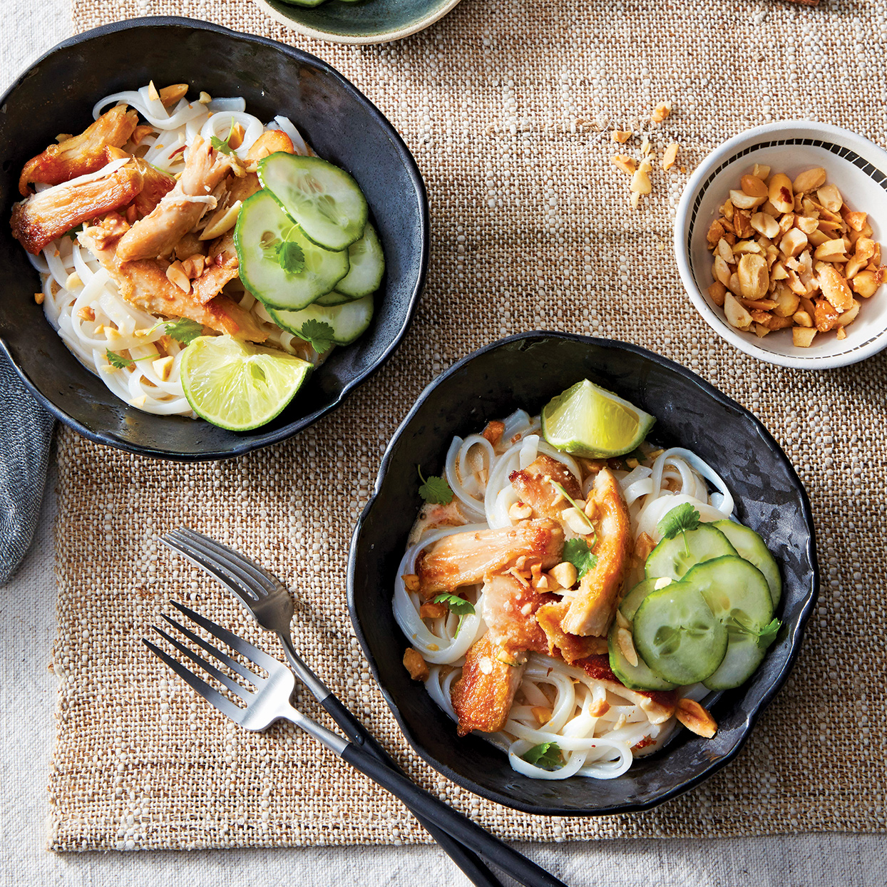 In this slow-cooker chicken recipe, minimal effort produces big flavor, making it the perfect starter recipe for anyone learning to cook their own Thai food. If you can't find wide rice noodles, any rice noodle can be substituted. For quickest day-of meal prep, make the chicken and coconut broth a day in advance and refrigerate. When ready to eat, simply reheat them, cook the noodles and serve. Source: Everyday Slow Cooker