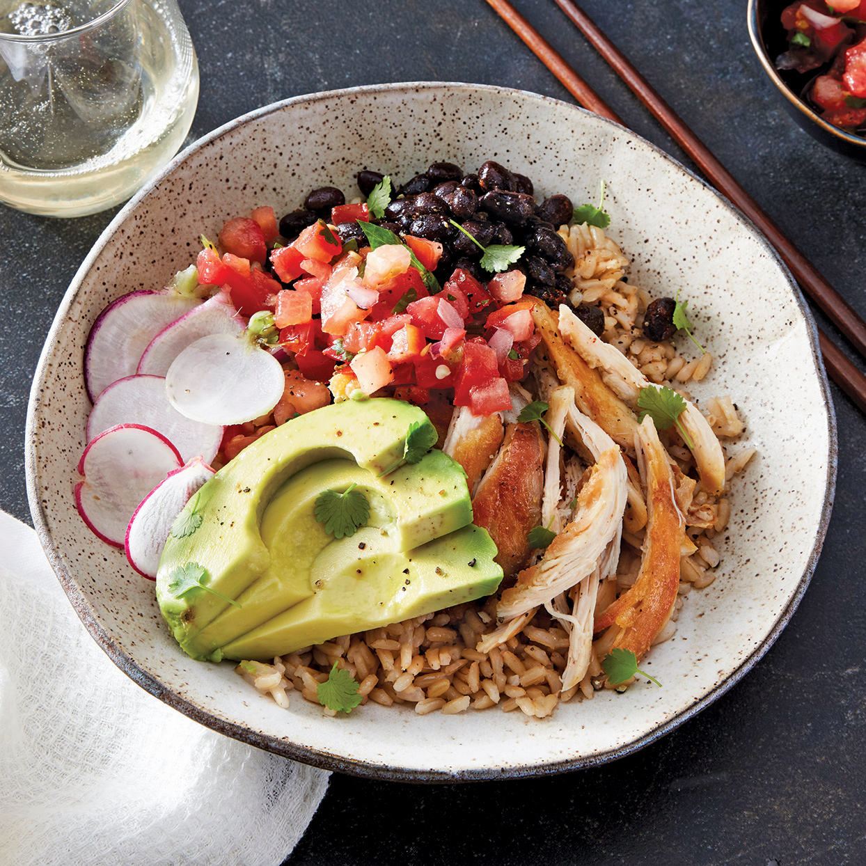A bowl of tender shredded chicken, hot cooked rice and slightly spicy black beans served with fresh toppings is a meal that will satisfy anytime. Make this slow-cooker chicken dish on the weekend and reheat throughout the week for easy at-work lunches or dinner at the end of a long day. For a variation, swap the brown rice for a grain medley. Source: Everyday Slow Cooker