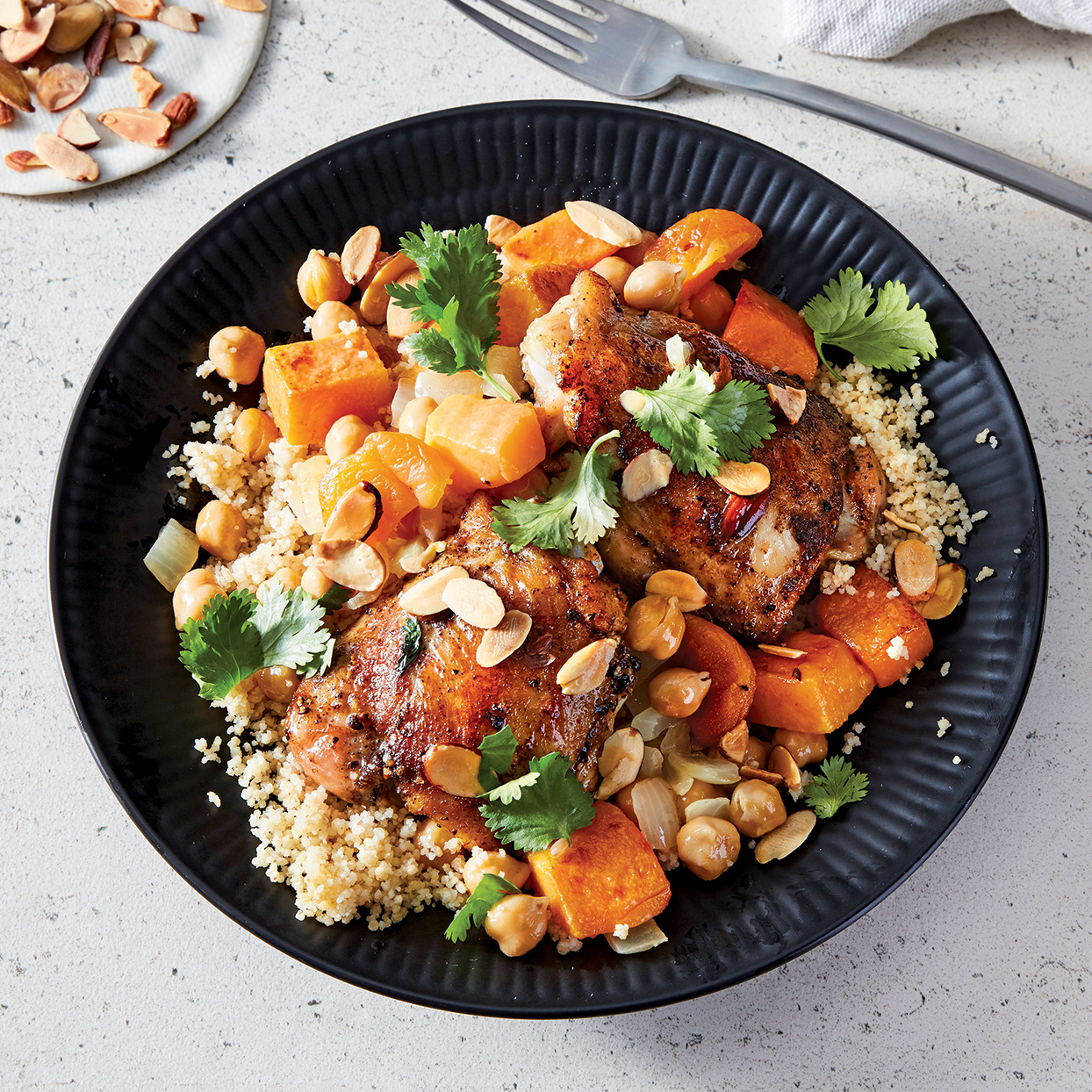 Loaded with chicken, onion, butternut squash, apricots, chickpeas and couscous, this slow-cooker recipe is not only bursting with color and texture, but it's also packed with protein and a host of vitamins and even contains a dose of fiber.