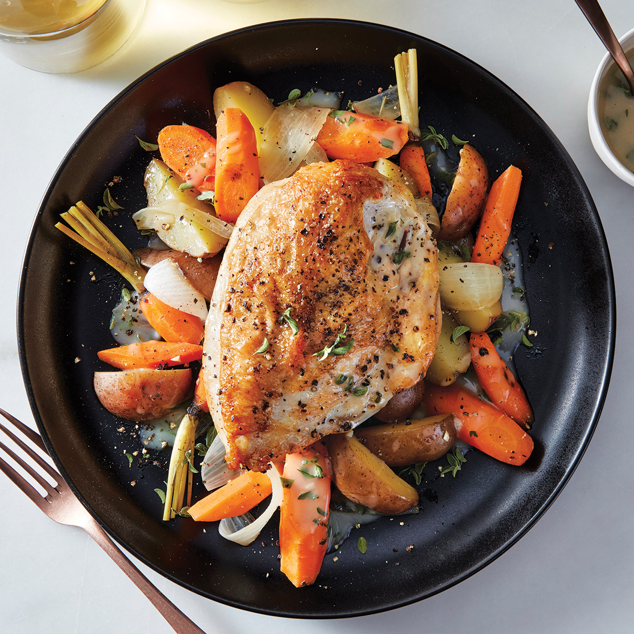 Impress the in-laws, neighbors or any other dinner guests with this pretty dish. It's a slow-cooker chicken recipe that actually looks and tastes like it was oven-roasted. To save time, prep the vegetables a day ahead or in the morning, and then refrigerate until ready to brown the meat and start the slow cooker.