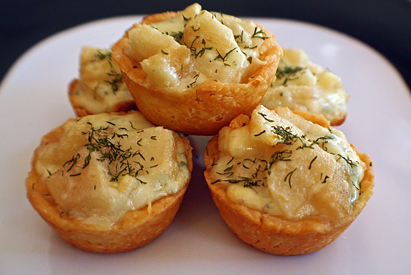 """You'll only need five ingredients for this easy finger food recipe, but guests will never know due to these tartlets' elegant appearance. """"Served them at a party and everyone gobbled them up and kept exclaiming how delicious they were,"""" says Allrecipes user kcbee."""