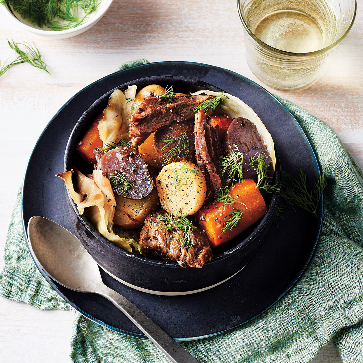 This slow-cooker chuck roast is winter comfort food at its finest. A bright, slightly sweet sauce balances the rich and tender braised beef. You can substitute multi-colored baby potatoes (halved) for the Yukon variety and fresh fennel fronds for the parsley, if desired.