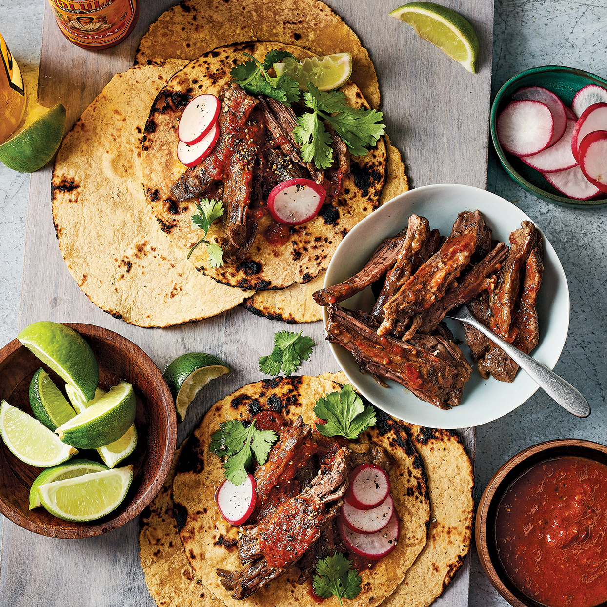 The meat in these slow-cooker tacos gets incredibly tender, thanks to plenty of time in the crock pot. The sauce in this dish is smoky and rich from the chiles, onion, fire-roasted tomatoes and beef. Toast the tortillas, if you'd like. Source: Everyday Slow Cooker