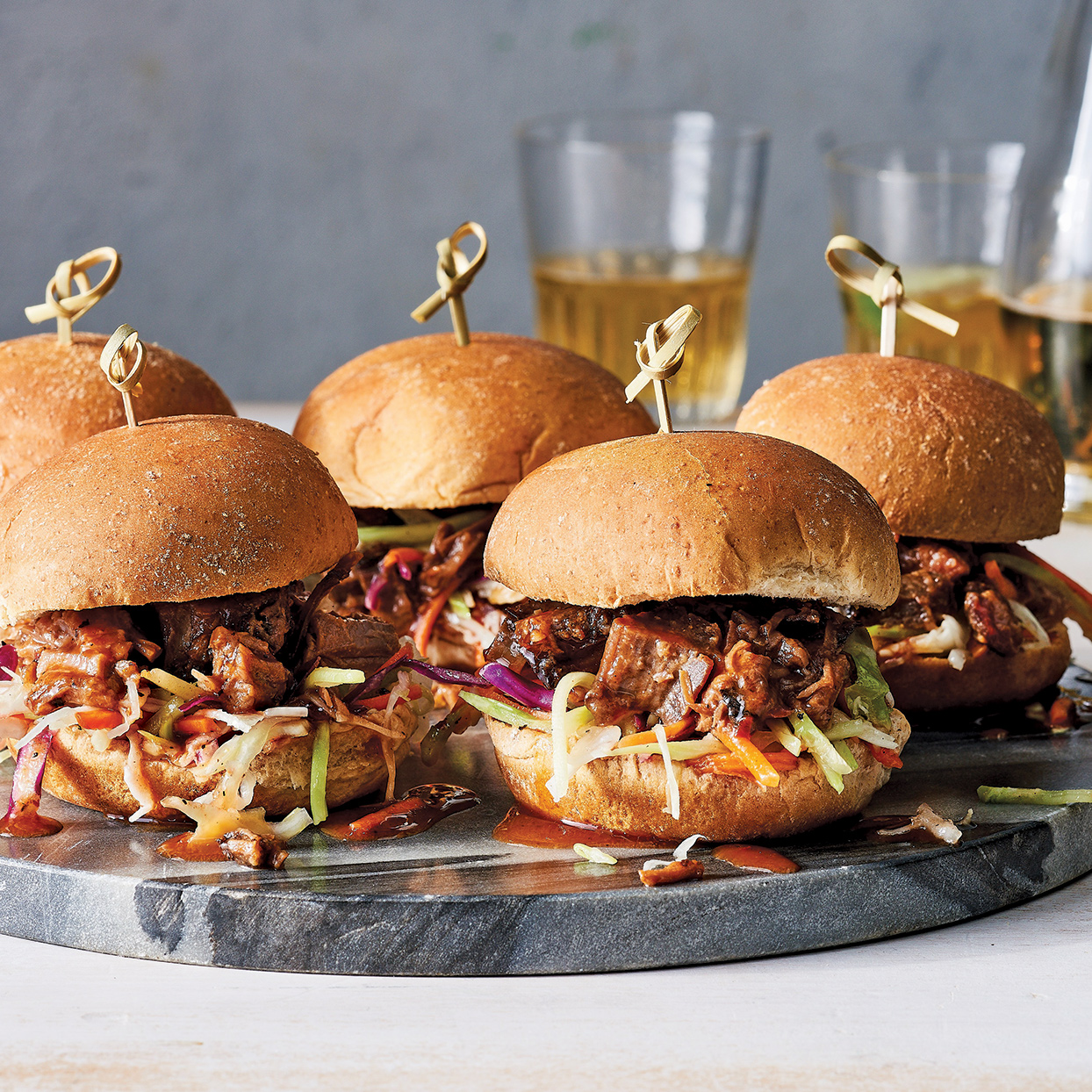 Serve these slow-cooker brisket sliders when company's coming--perhaps to watch the big game--for an easy, crowd-pleasing dish. The crisp, tangy coleslaw is the perfect pairing for the tender, rich brisket. Serve with chips, crudités and cold beer to round out the meal. Source: Everyday Slow Cooker
