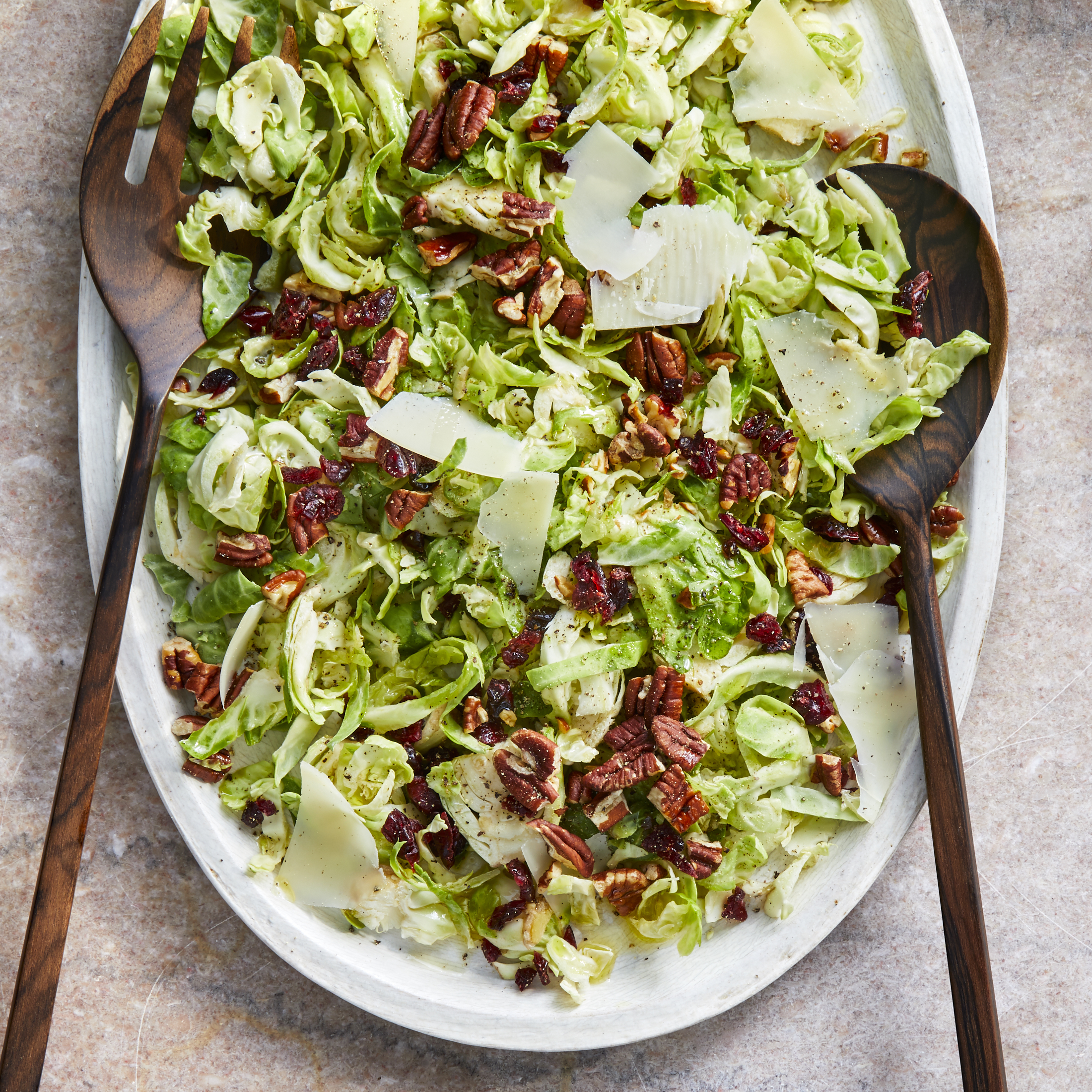 This raw Brussels sprouts salad featuring shaved Brussels sprouts, toasted pecans, sweet-tart cranberries and nutty Parmesan cheese is tossed with a light and lemony vinaigrette. You can shave the Brussels sprouts using a chef's knife--or use the slicing attachment of your food processor to make it even easier. This quick and easy recipe is perfect for fall or anytime you have crisp, fresh Brussels sprouts on hand. Source: EatingWell.com, November 2019