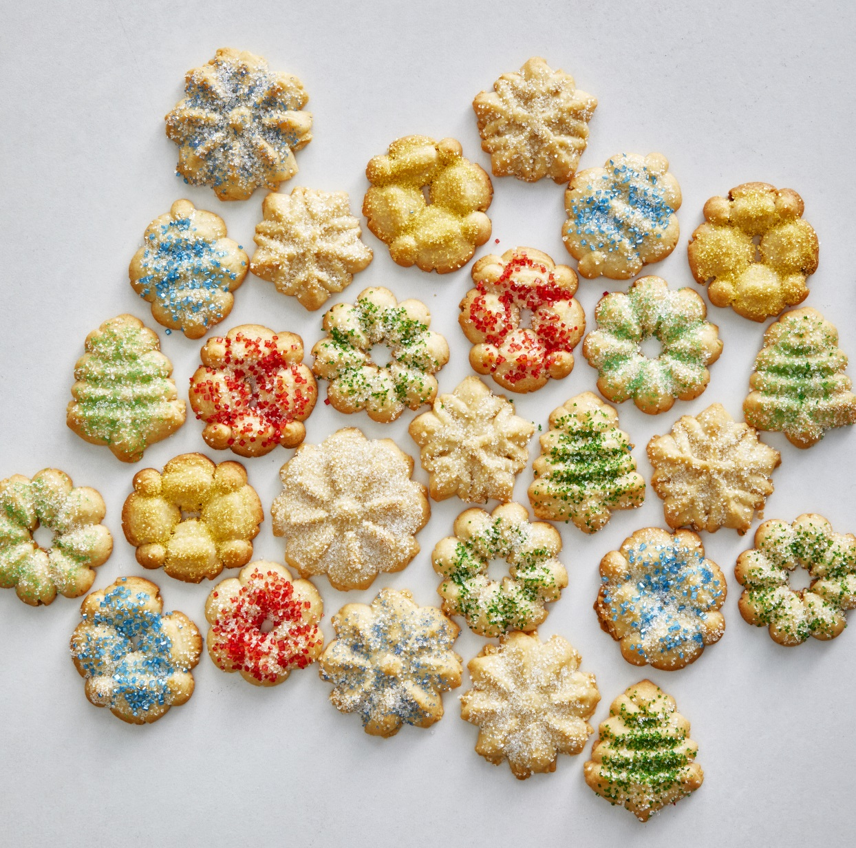 It's time to break out your spritz cookie press for these festive Christmas spritz cookies! These easy Christmas cookies can be decorated with sprinkles or flavored with citrus, spices or sweet sugar glaze. And if you're looking for healthy cookies, these fit the bill thanks to whole-wheat pastry flour that keeps their texture soft while giving them a boost of fiber. For ideas on how to dress up these spritz cookies even more with different flavorings or a glaze, see Tips below. Source: EatingWell.com, November 2019