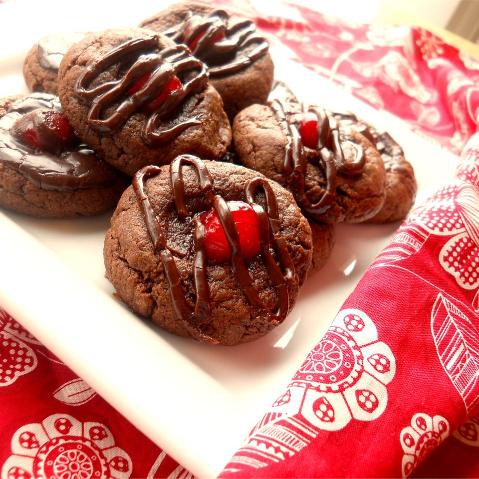 """Chocolate-covered cherries perch on chocolate cookies! """"Delicious! Easy to make, too. Took barely 30 minutes to do everything from mixing the batter to making the frosting to baking,"""" says Sara."""