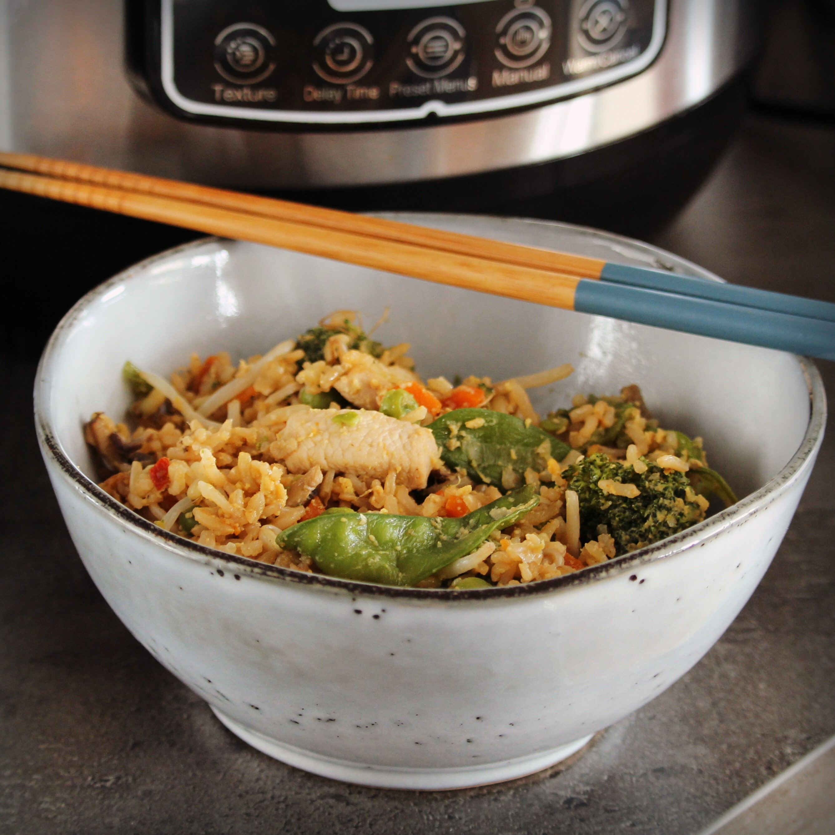 "Traditional chicken fried rice cooks even faster in your electric pressure cooker. ""This Instant Pot method gives you a fluffy and flavorful meal, but eliminates the need to start with already-cooked rice,"" says Buckwheat Queen. ""You can have a wholesome version of your takeout favorite in about the same time it would take for it to be delivered to your door."""