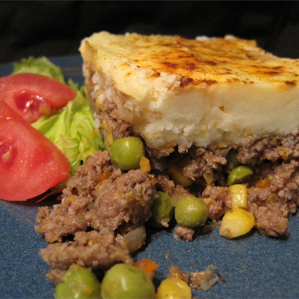 "Another classic comfort food casserole. It's a complete meat and potatoes and veggies meal. Christine says, ""This is a handy, quick dinner casserole! Ground beef and frozen vegetables are seasoned and topped with mashed potatoes."""