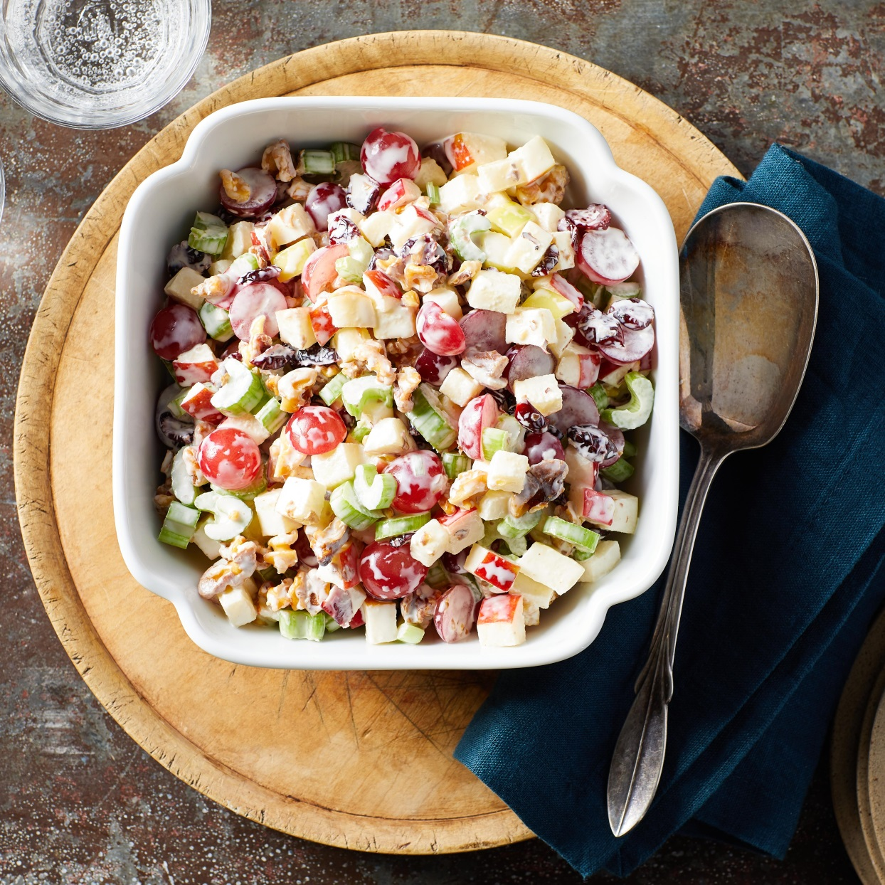 We've dressed the classic Waldorf salad up for Christmas by swapping out the raisins for festive dried cranberries. A combination of Greek yogurt and mayonnaise makes the salad creamy while keeping it light.