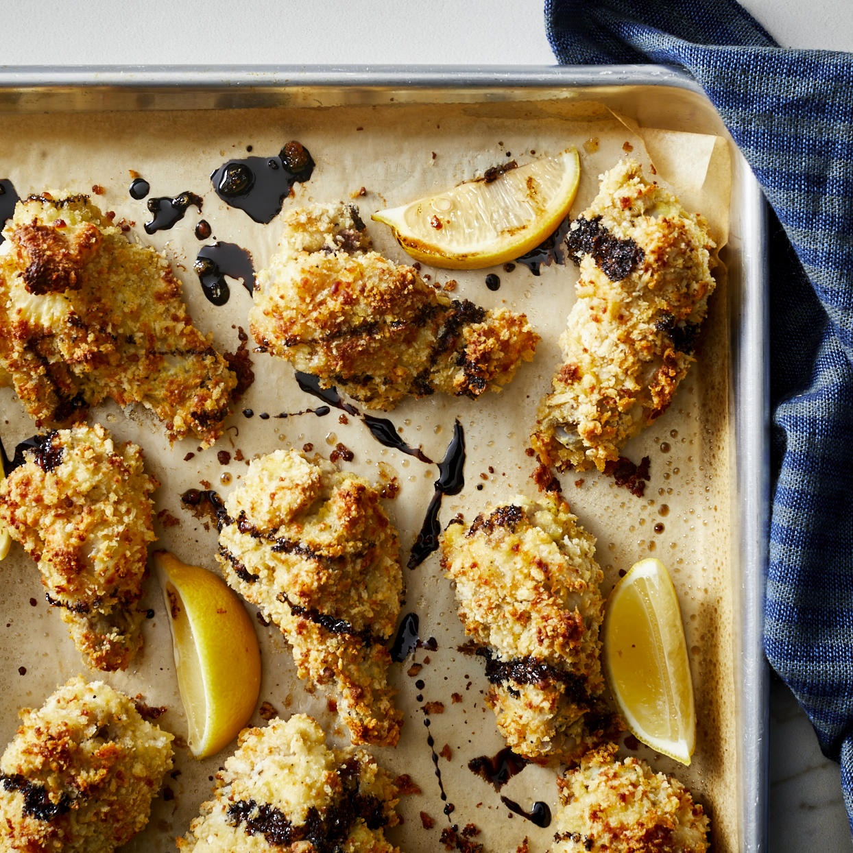 Forget the fryer--these baked garlic-Parmesan chicken wings get a crispy coating (without tons of oil) from panko breadcrumbs combined with grated Parmesan cheese. A drizzle of balsamic vinegar glaze gives this healthy appetizer a sweet and tangy finishing note. Source: EatingWell.com, December 2019