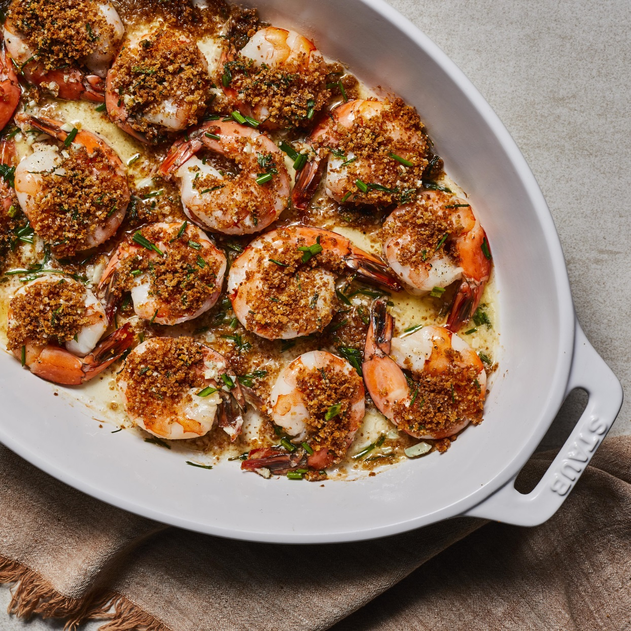 This easy baked shrimp dish is crispy, lemony, garlicky, buttery and simply delicious! Toasting the panko before topping the shrimp makes for a super-crispy topping. Serve these flavorful shrimp with over angel-hair pasta and add a green salad or a side of vegetables for a quick dinner that's simple enough for weeknights but fancy enough to serve to company. Source: EatingWell.com, December 2019