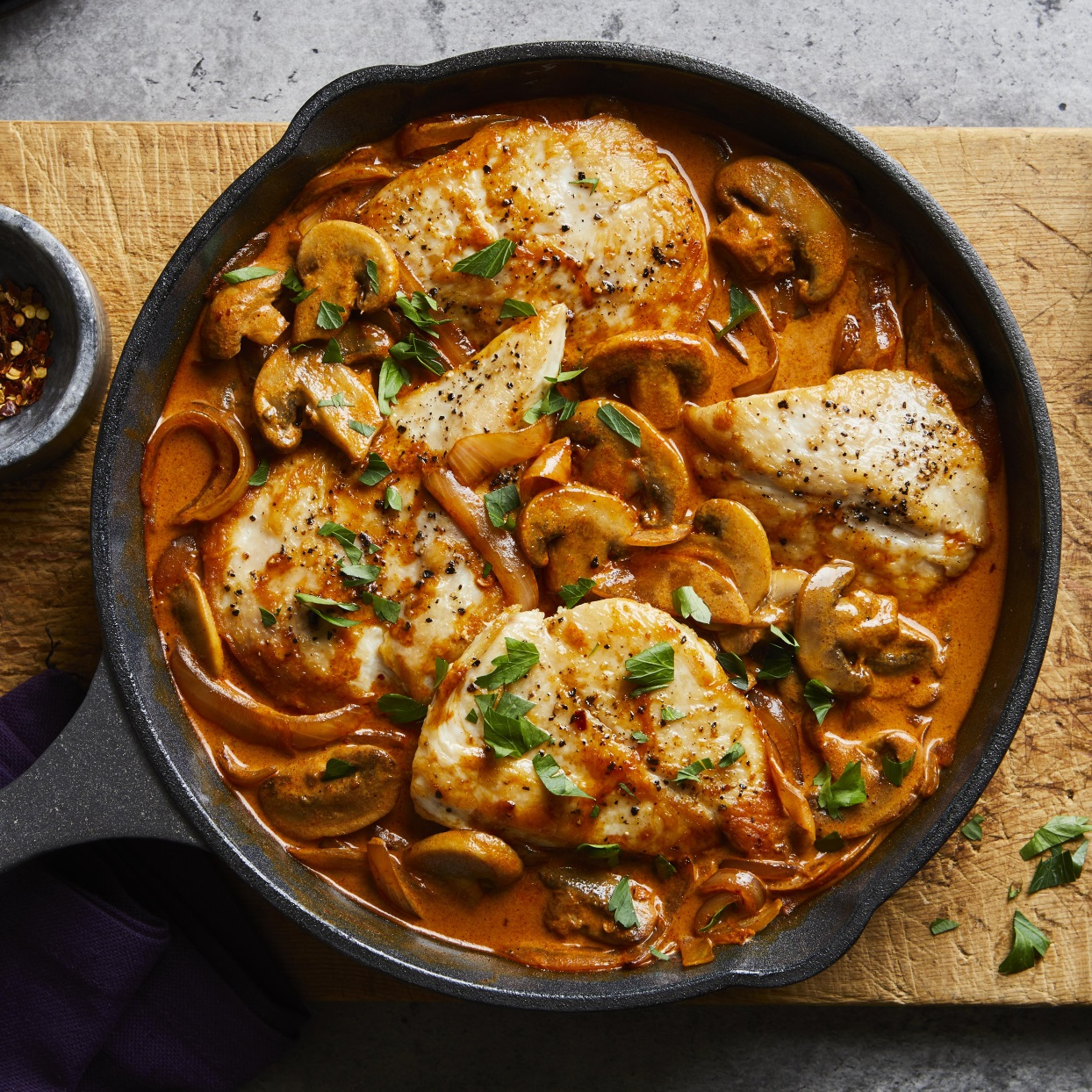 Try this quick and easy one-skillet version of the Hungarian classic chicken paprikash. Serve the chicken cutlets, mushrooms and creamy sauce over egg noodles with a green salad on the side.