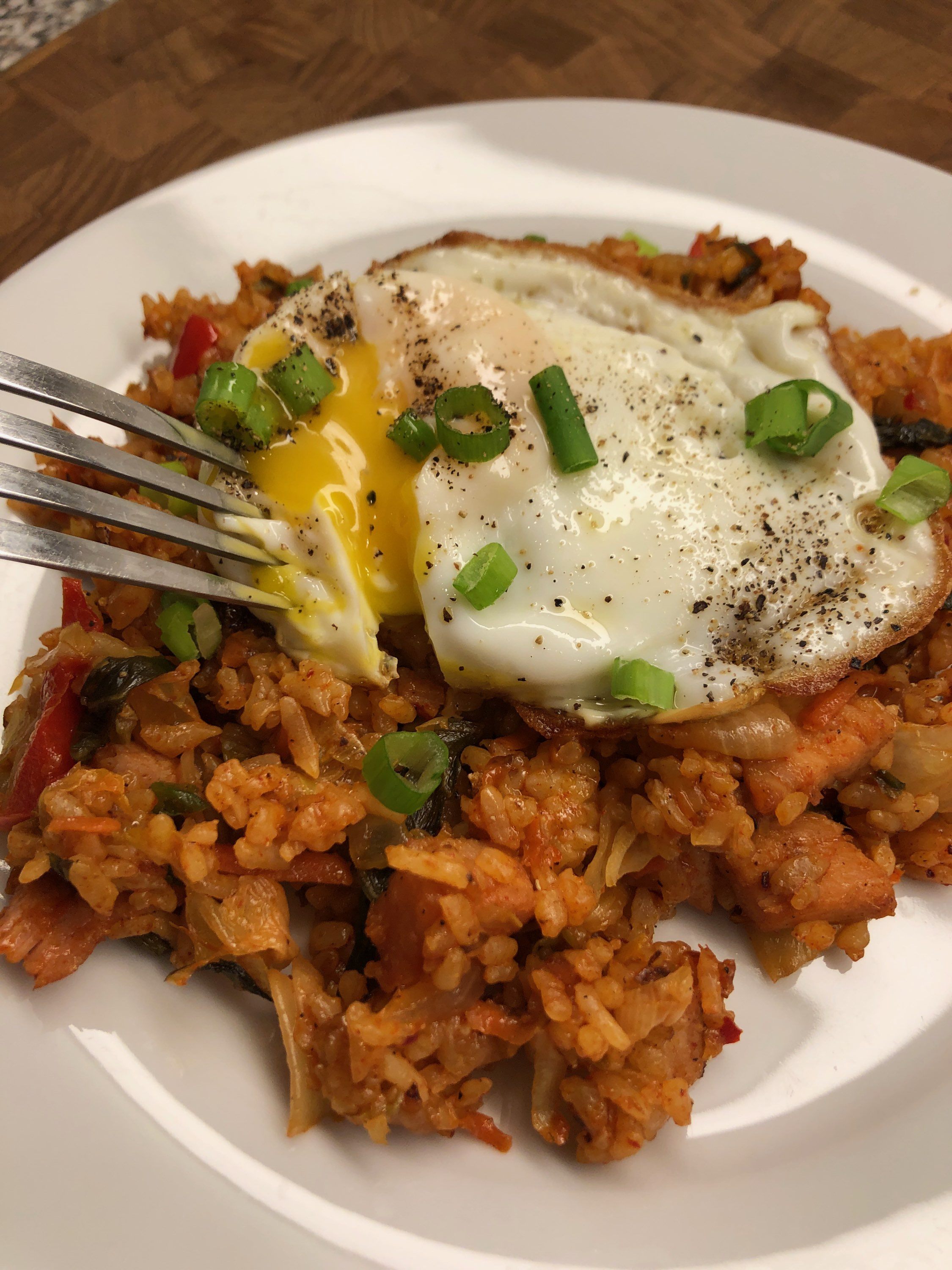 """This is a very basic kimchi fried rice, a humble dish made with leftover rice, kimchi, and usually a processed meat like Spam,"" says Diana71. ""In this recipe I used cubed ham and veggies I had in the fridge. Serve with a sunny side up egg over top if you like."""