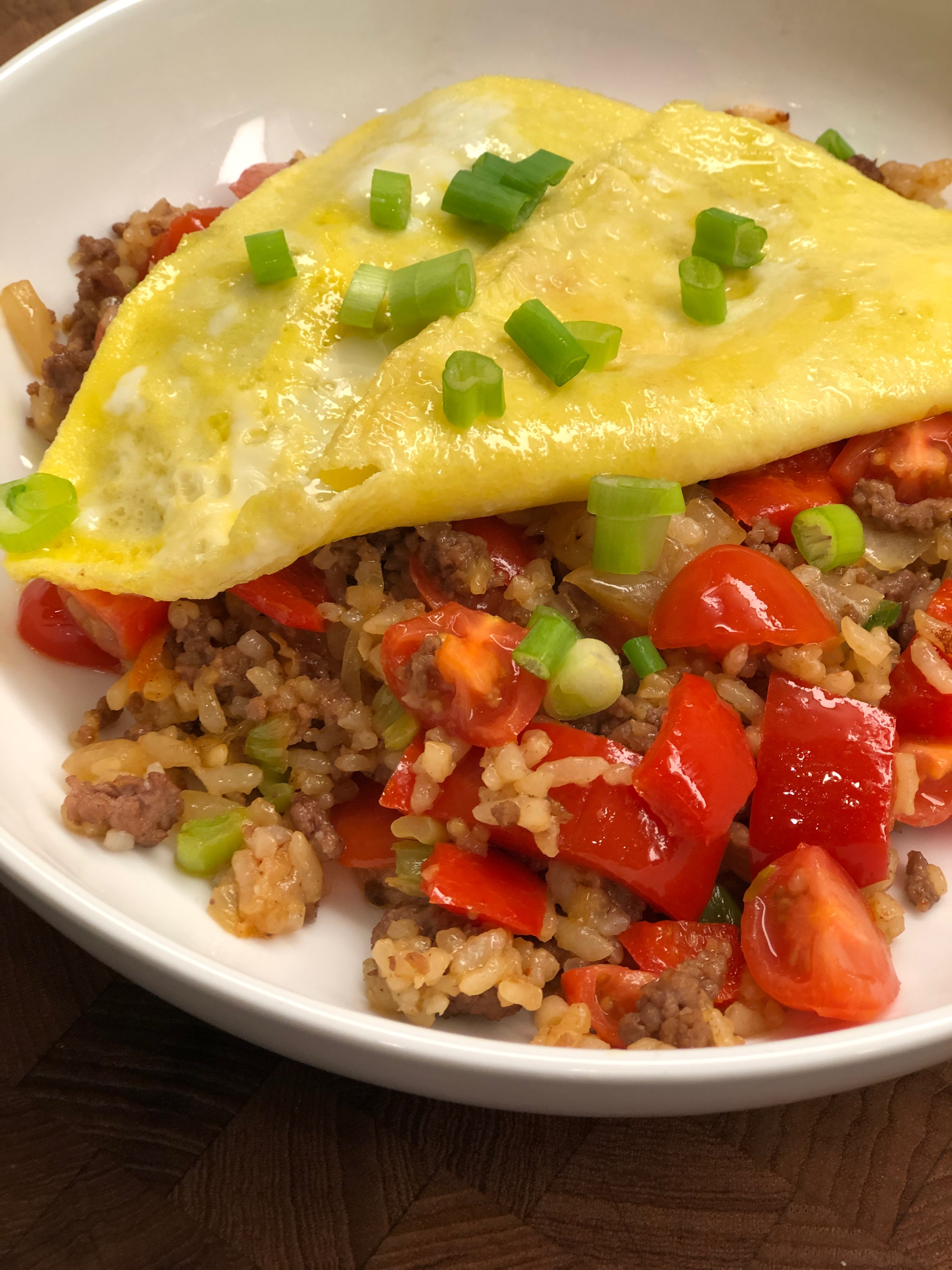 """This fried rice is made with ground beef, and is Thai home cooking at its best!"" says Diana71. ""Enjoy the delicious flavor that the soy sauce, fish sauce, and fresh tomato bring to this version of fried rice."""