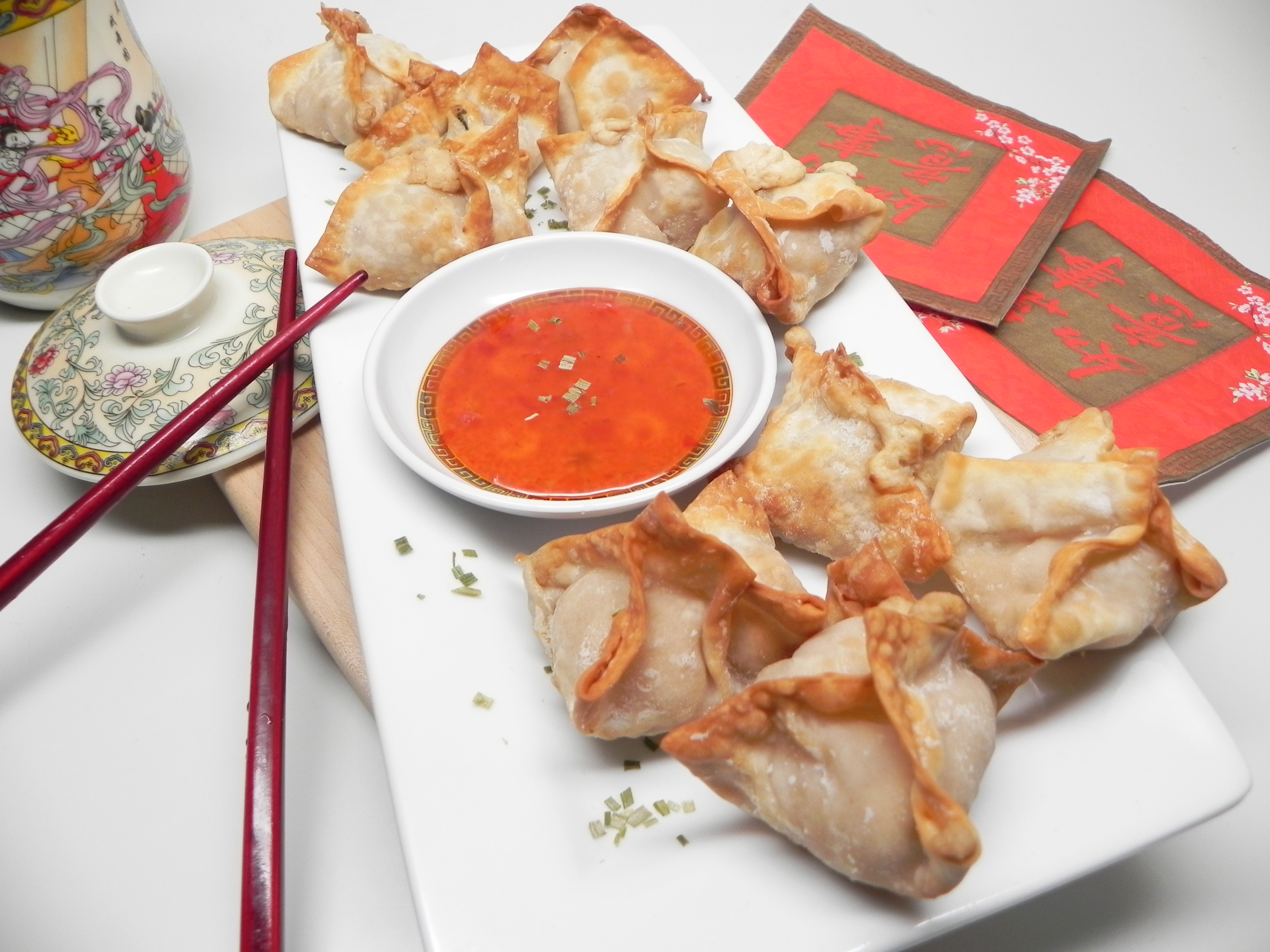 """""""Super crispy exterior with warm and fluffy pillow centers is what you'll get with this air fryer crab rangoon recipe,"""" says Soup Loving Nicole. """"Serve with sweet chili sauce for dipping, if desired."""""""