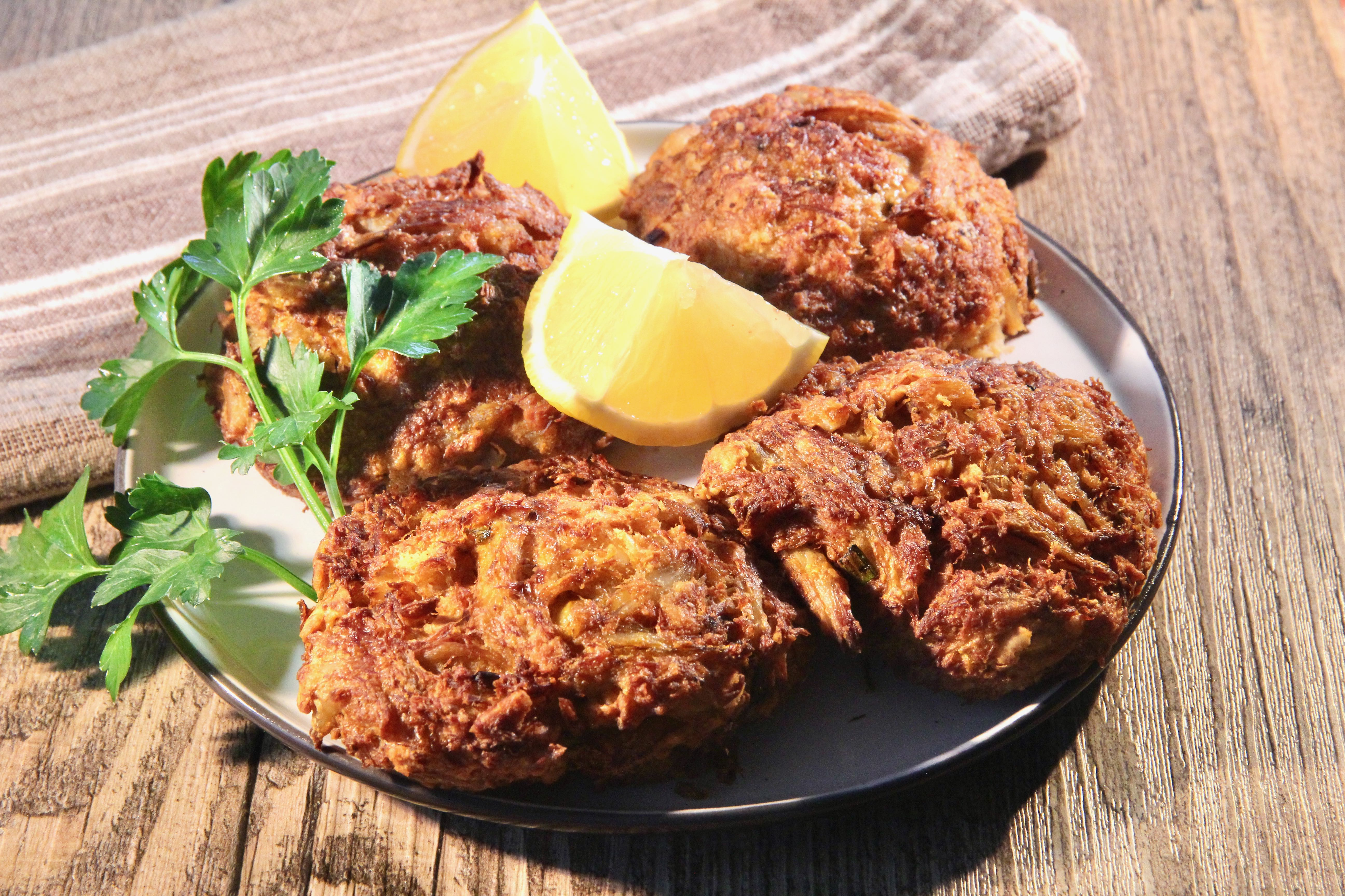 """""""Air frying crab cakes means less mess and less cleanup, but at no sacrifice to taste,"""" says lutzflcat. """"They're flavorful, crisp, and lighter than if cooked with oil in a skillet. Serve with your favorite dipping sauce, aioli, or tartar sauce, as well as fresh lemon wedges."""""""