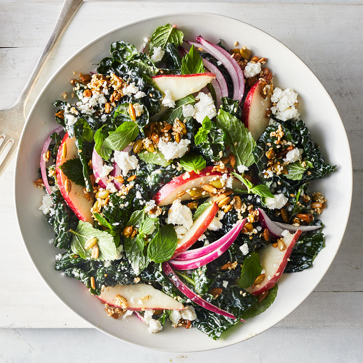 The crunchy seed topping is the perfect textural juxtaposition to a creamy dressing, soft pears and tender massaged kale salad. Tossing it all with mint, feta and red onion gives it a Middle Eastern flair. Source: EatingWell Magazine, January/February 2020