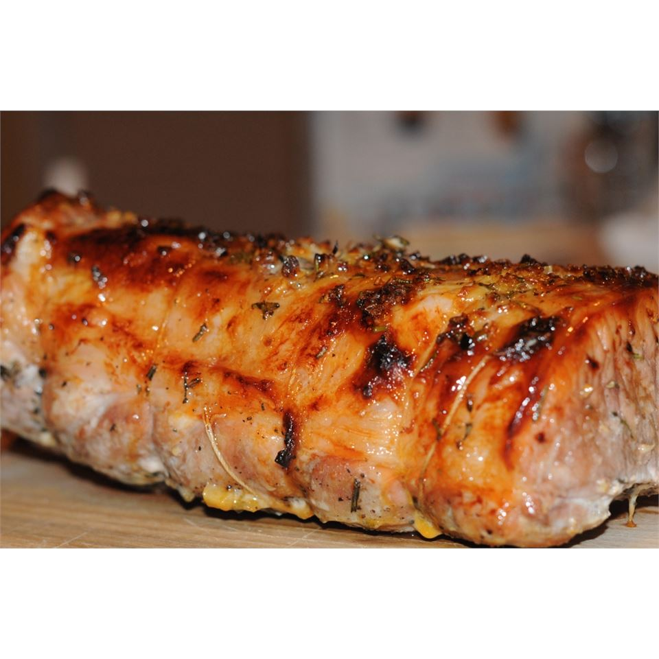 Rosemary-Scented Pork Loin Stuffed With Roasted Garlic, Dried Apricots and Cranberries and Port Wine Pan Sauce Nina