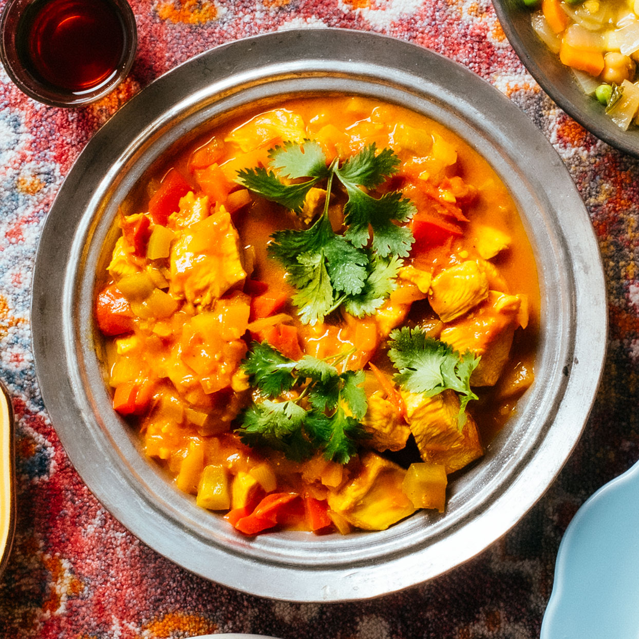 Naseema Kashefi prepares this richly flavored chicken curry on the milder side for New Arrival Supper Club events in Los Angeles. Add more serrano if you like it hot.Source: EatingWell Magazine, January/February 2020